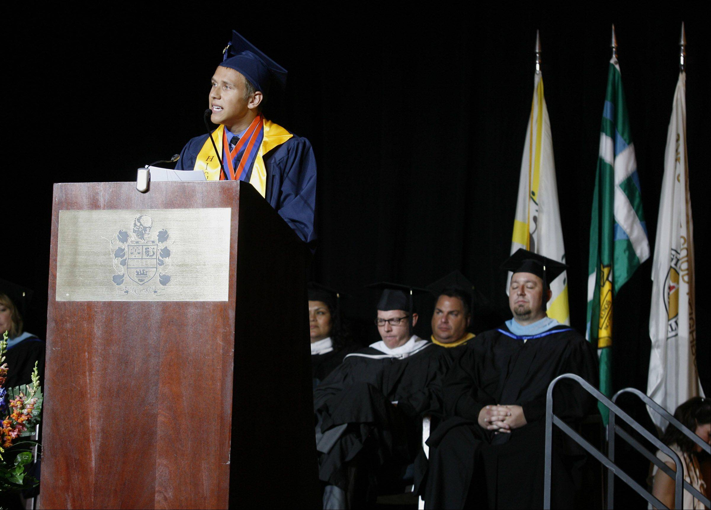 Buffalo Grove High School graduate Tyler Nelson speaks at the school's graduation ceremony in Buffalo Grove Sunday.