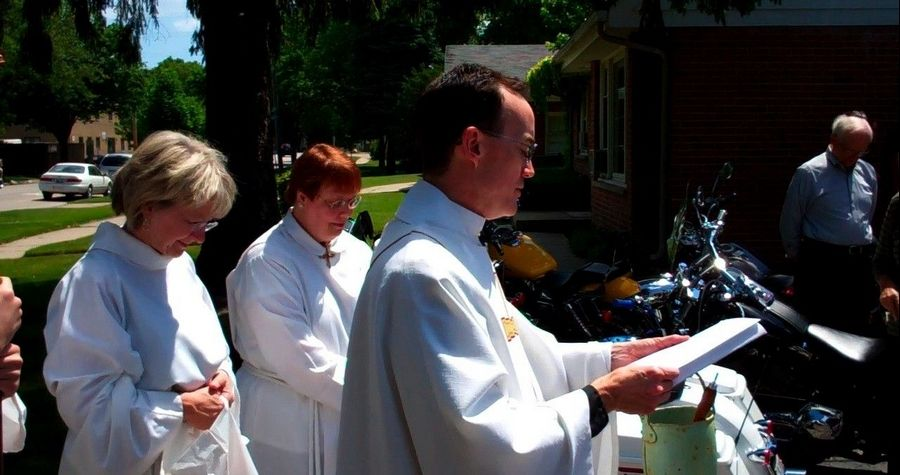 The Rev. Steven R. Godfrey, rector of St. Martin's Episcopal Church in Des Plaines, blesses motorcycles and their riders during the first Blessing of the Bikes ceremony Sunday. Along with the church bikers, members of Willow Creek Community Church's Highroad Riders group also attended.