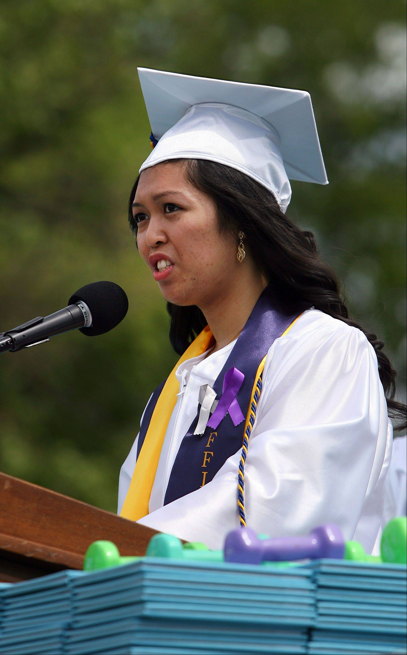 Jean Manianglung gives the welcome address during the Maine West High School graduation ceremony in Des Plaines Sunday.