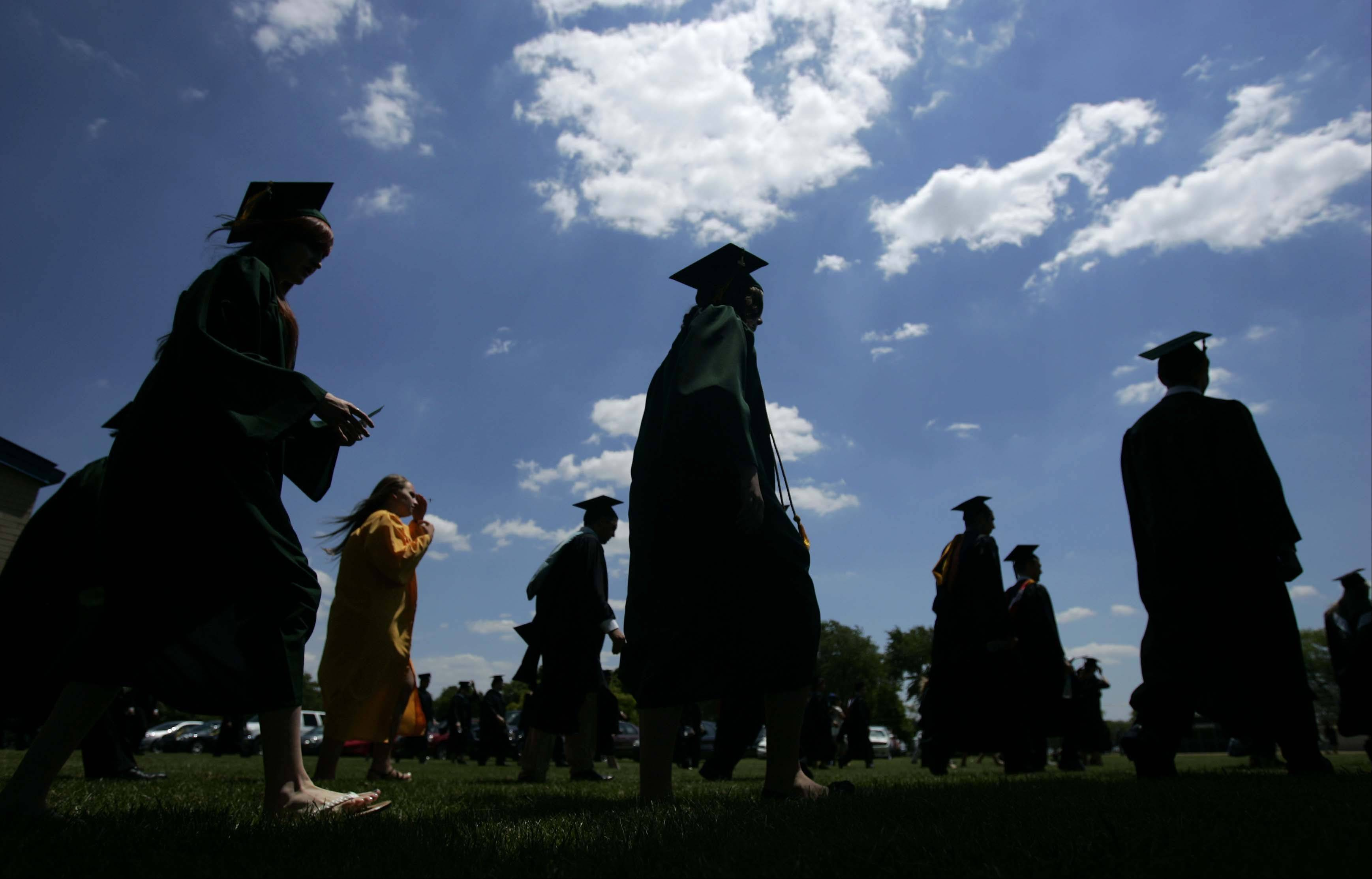 Graduates walk to the stadium for the forty-fifth Elk Grove High School graduation ceremony Sunday June 3, 2012.