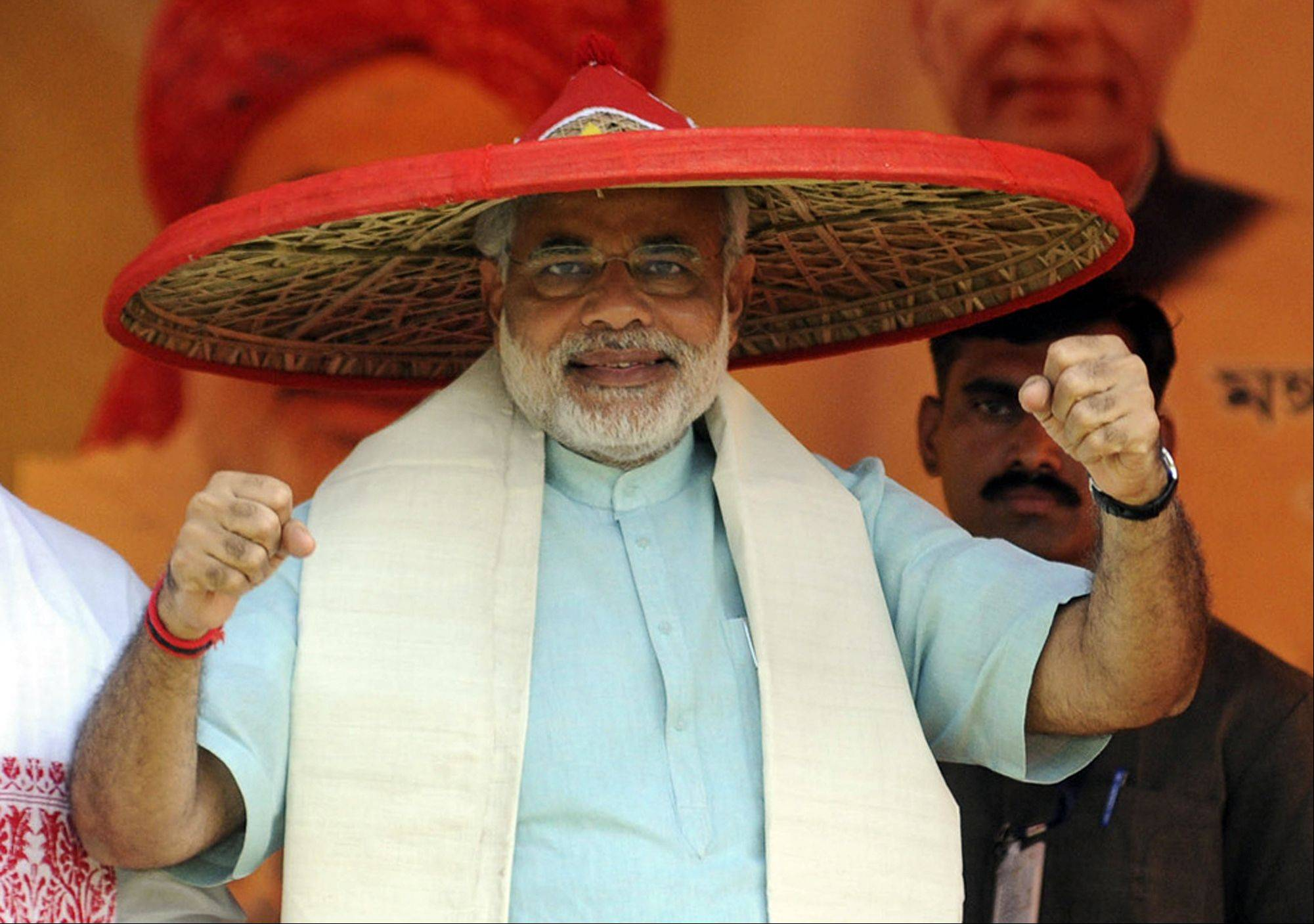 Gujarat Chief Minister Narendra Modi wears a traditional hat during a rally in 2009 in India.