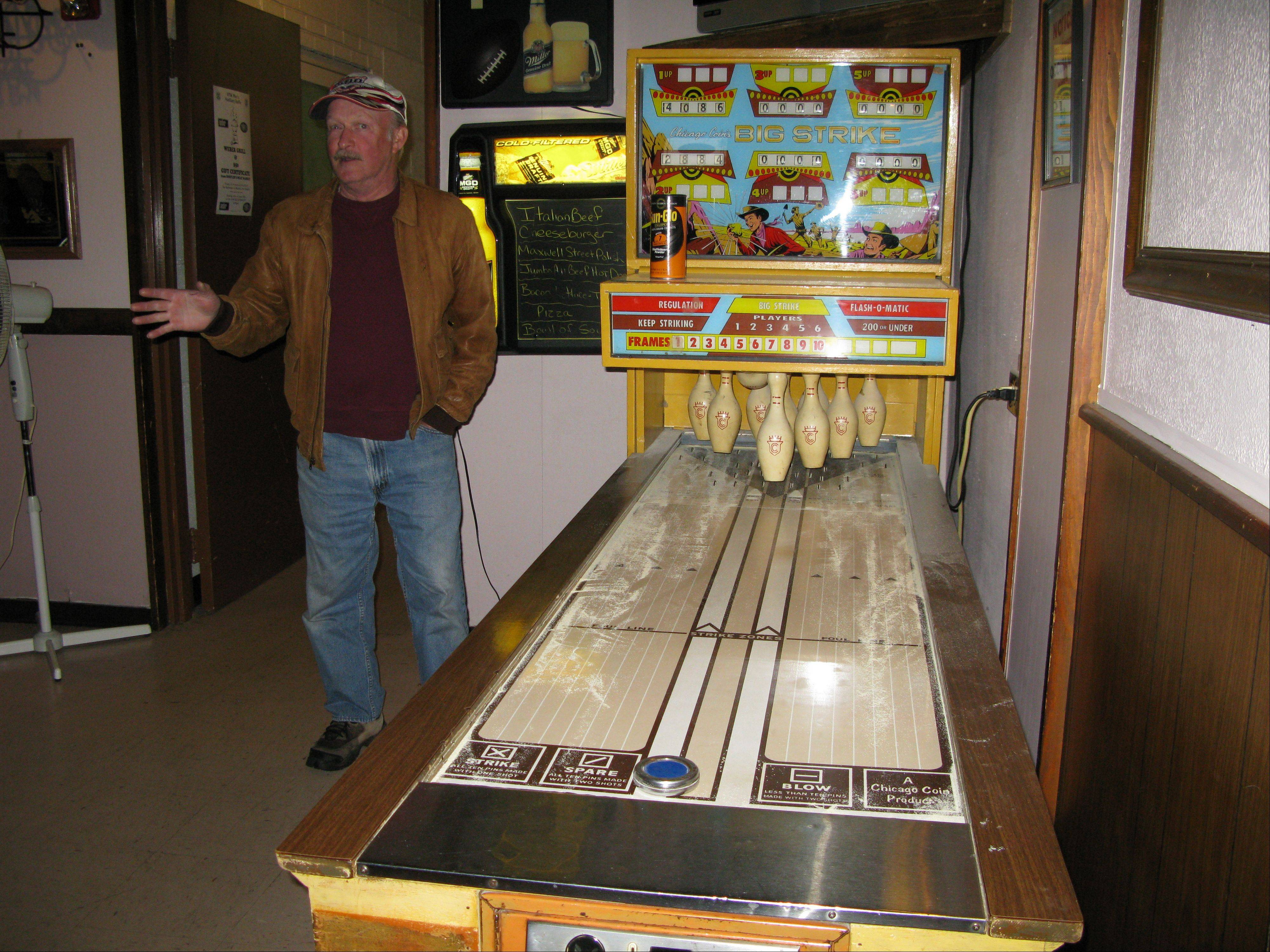 Merle Crumb, president of the Elk Grove Village Veterans Club Inc. hopes to replace this pinball machine with video gambling machines if the village board allows video gambling in town.