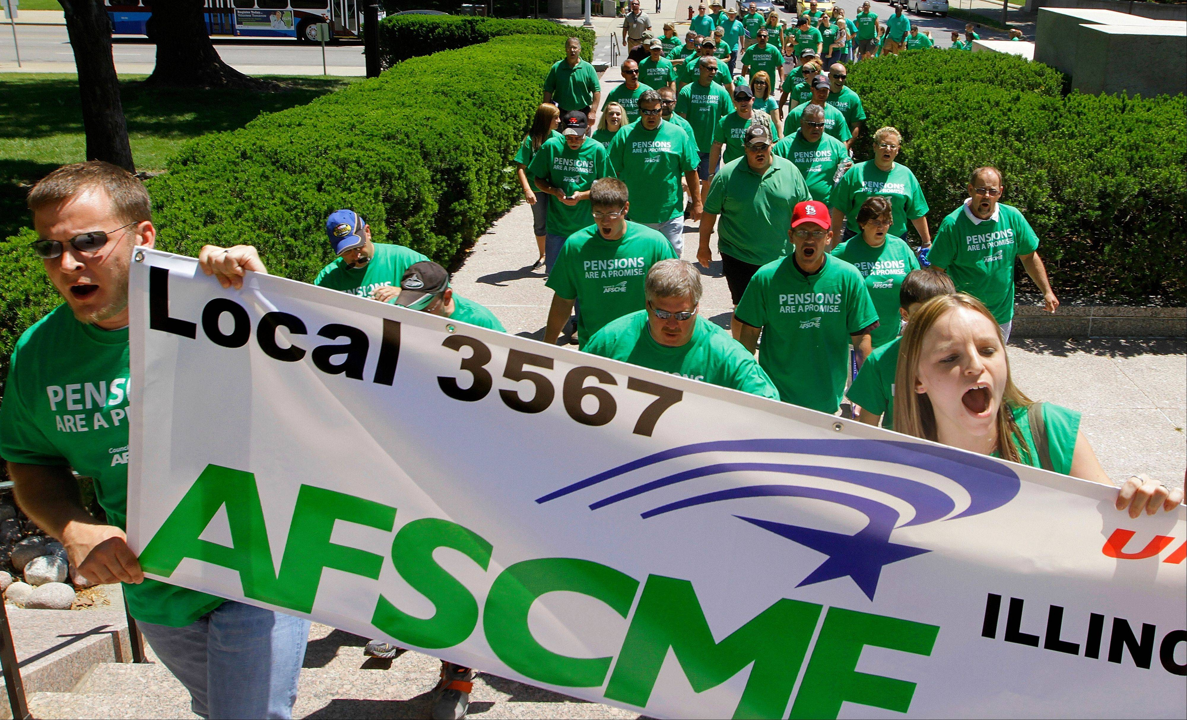 American Federation of State County and Municipal Employees union members, friends and family rally against the proposed pension legislation outside the at the Illinois State Capitol Wednesday, May 23, 2012 in Springfield, Ill. Lawmakers face big decisions on the twin problems of Medicaid and state pensions before going home to face voters in an election year and meet the General Assembly's June 1, 2012, deadline.