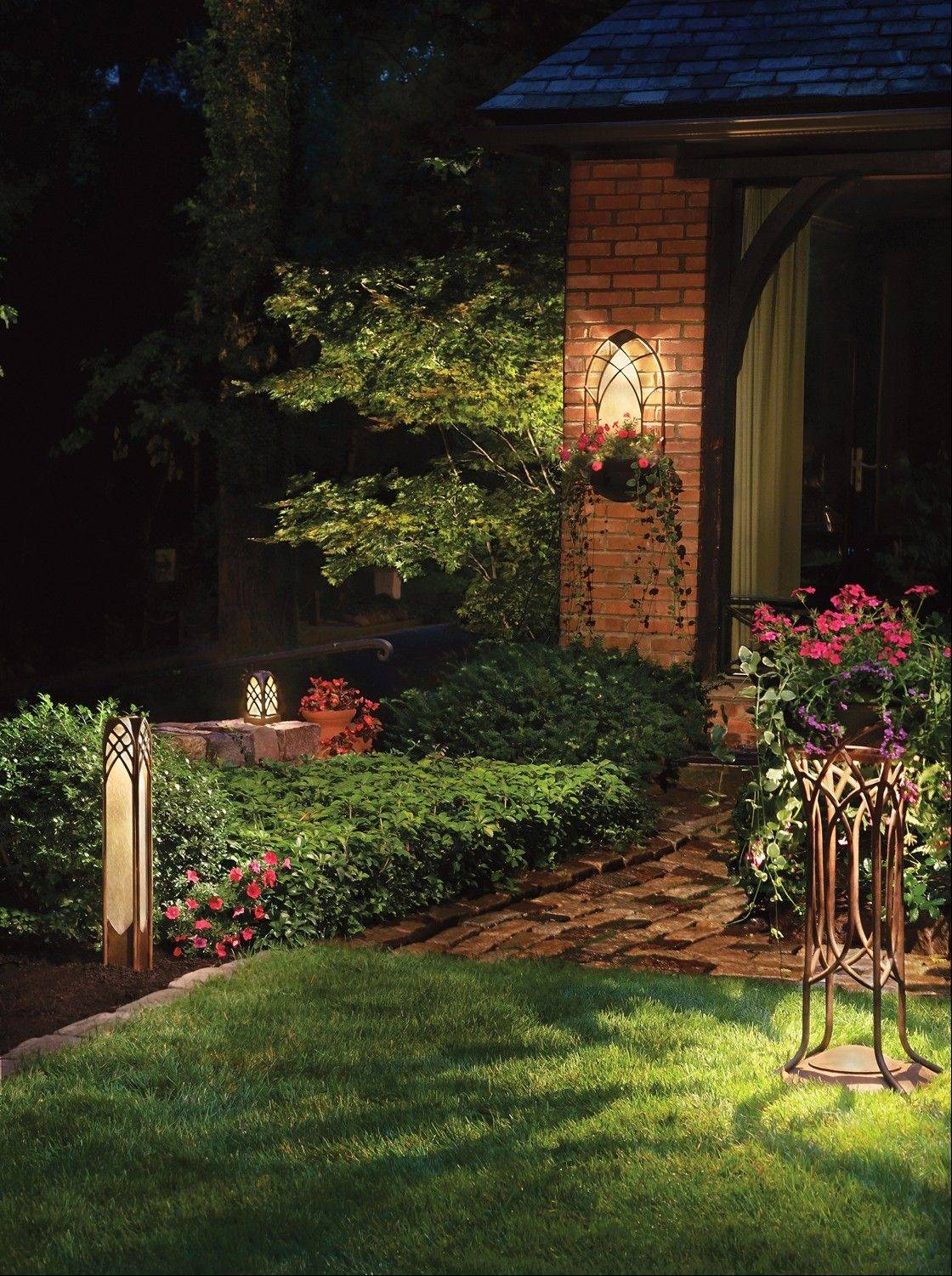 Your path can be lighted with decorative fixtures or ones that fade into the background.