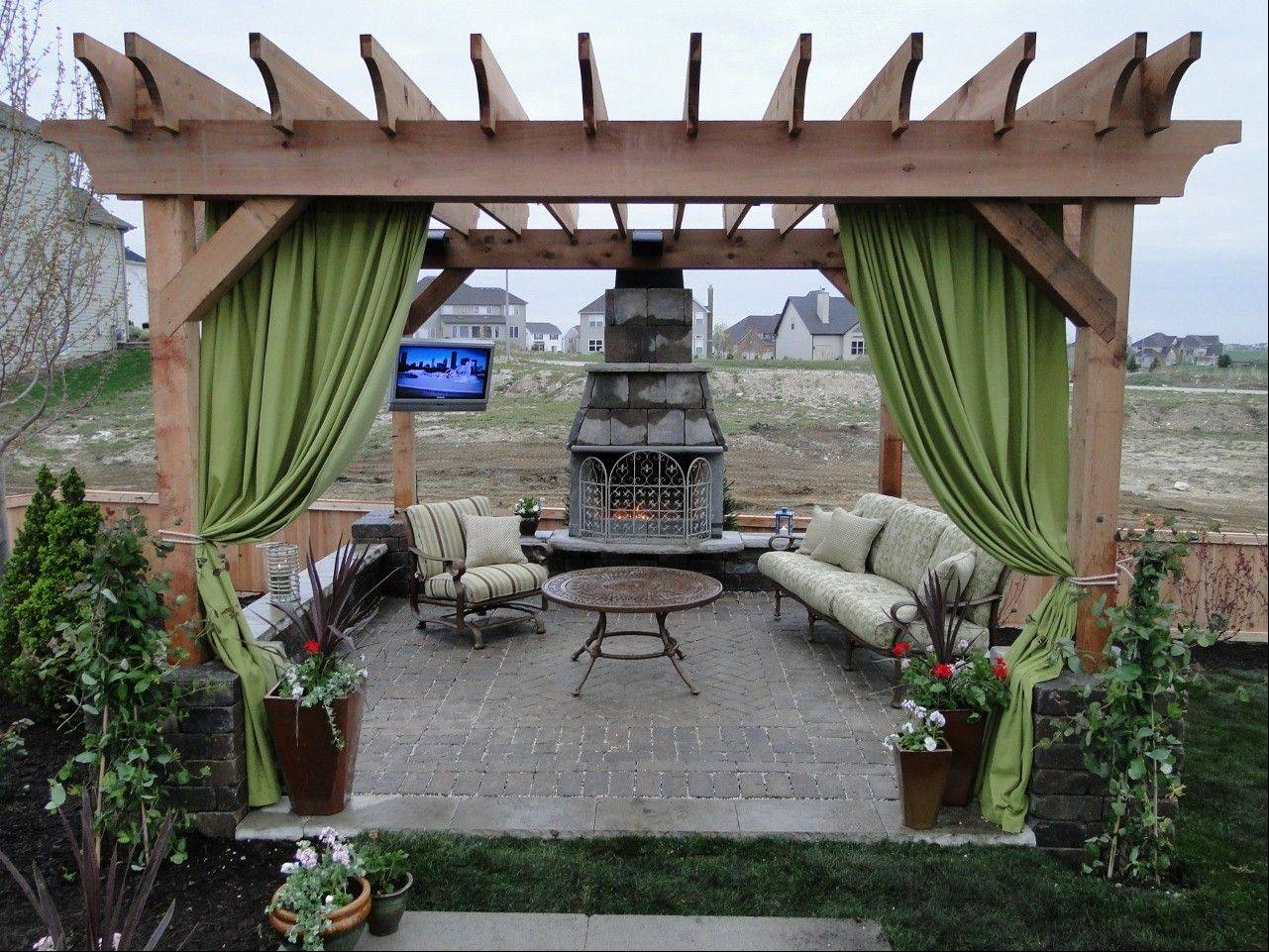 Lori and Michael Anthony of 1 Design Group did not forget the television when they took on a Plainfield yard for Yard Crashers on the DIY Network.