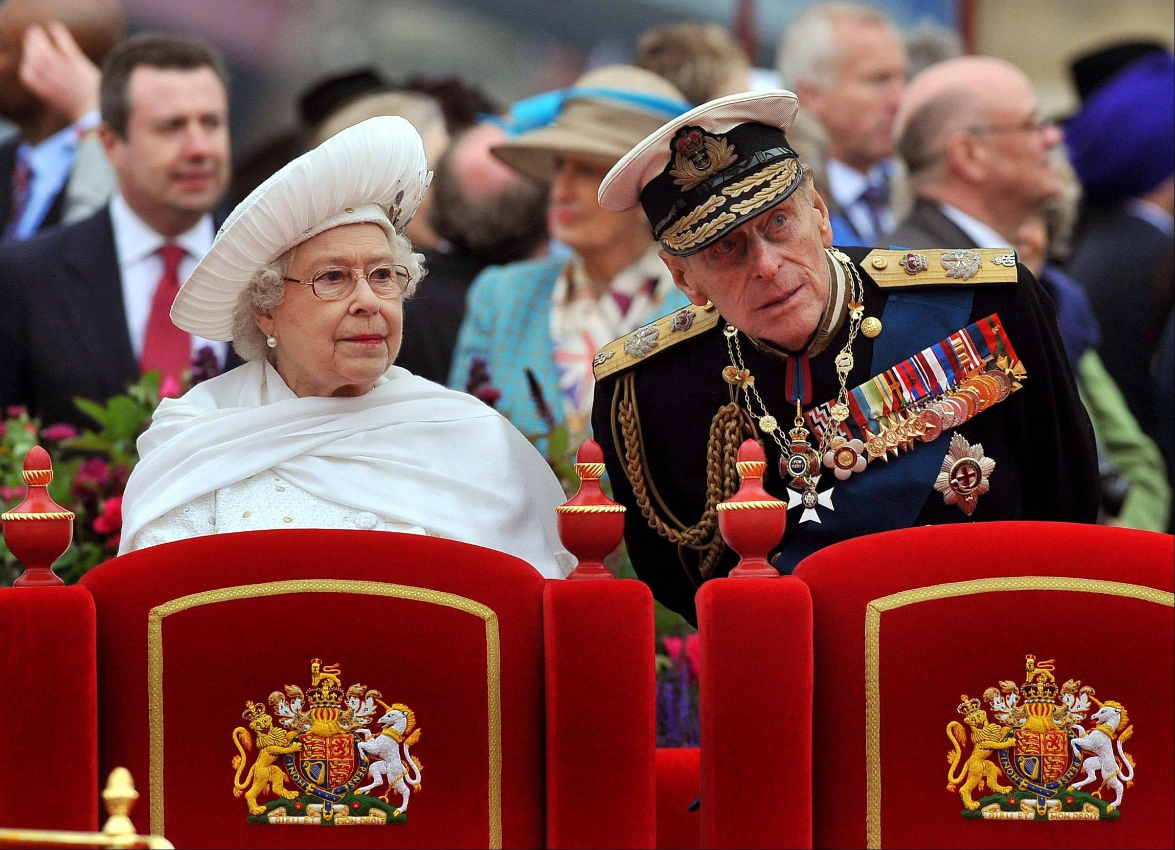 A Sunday June 3, 2012 photo from files showing Britain's Queen Elizabeth II, and her husband Prince Philip watching the proceedings from the royal barge during the Diamond Jubilee Pageant on the River Thames in London. Buckingham Palace says Prince Philip, husband of Queen Elizabeth II, has been hospitalized with a bladder infection. The 90-year-old prince has been taking part in celebrations of the queen�s Diamond Jubilee.