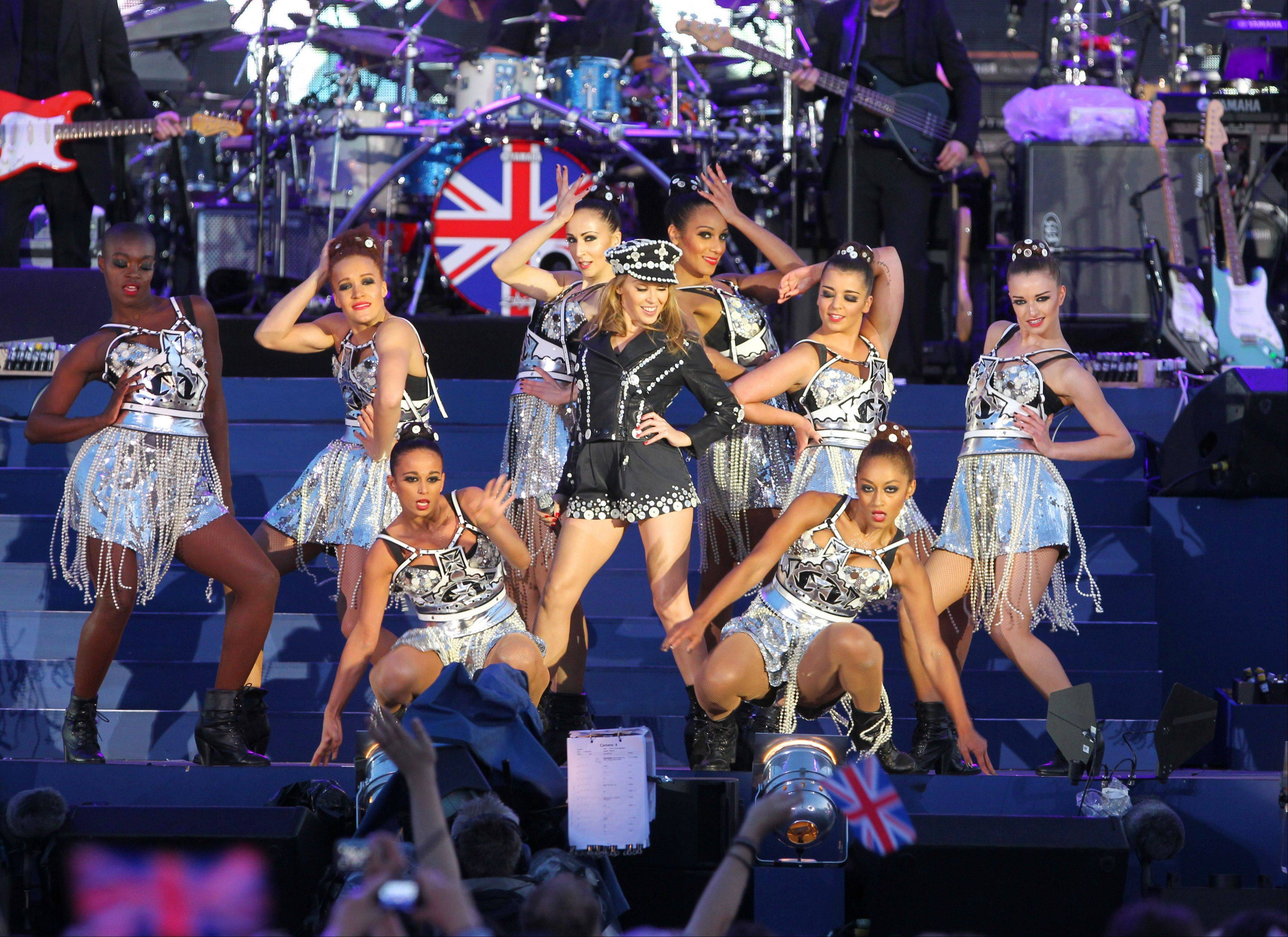 Kylie Minogue, centre, performs at the Queen's Jubilee Concert in front of Buckingham Palace, London, Monday, June 4, 2012. The concert is a part of four days of celebrations to mark the 60-year reign of Britain's Queen Elizabeth II.