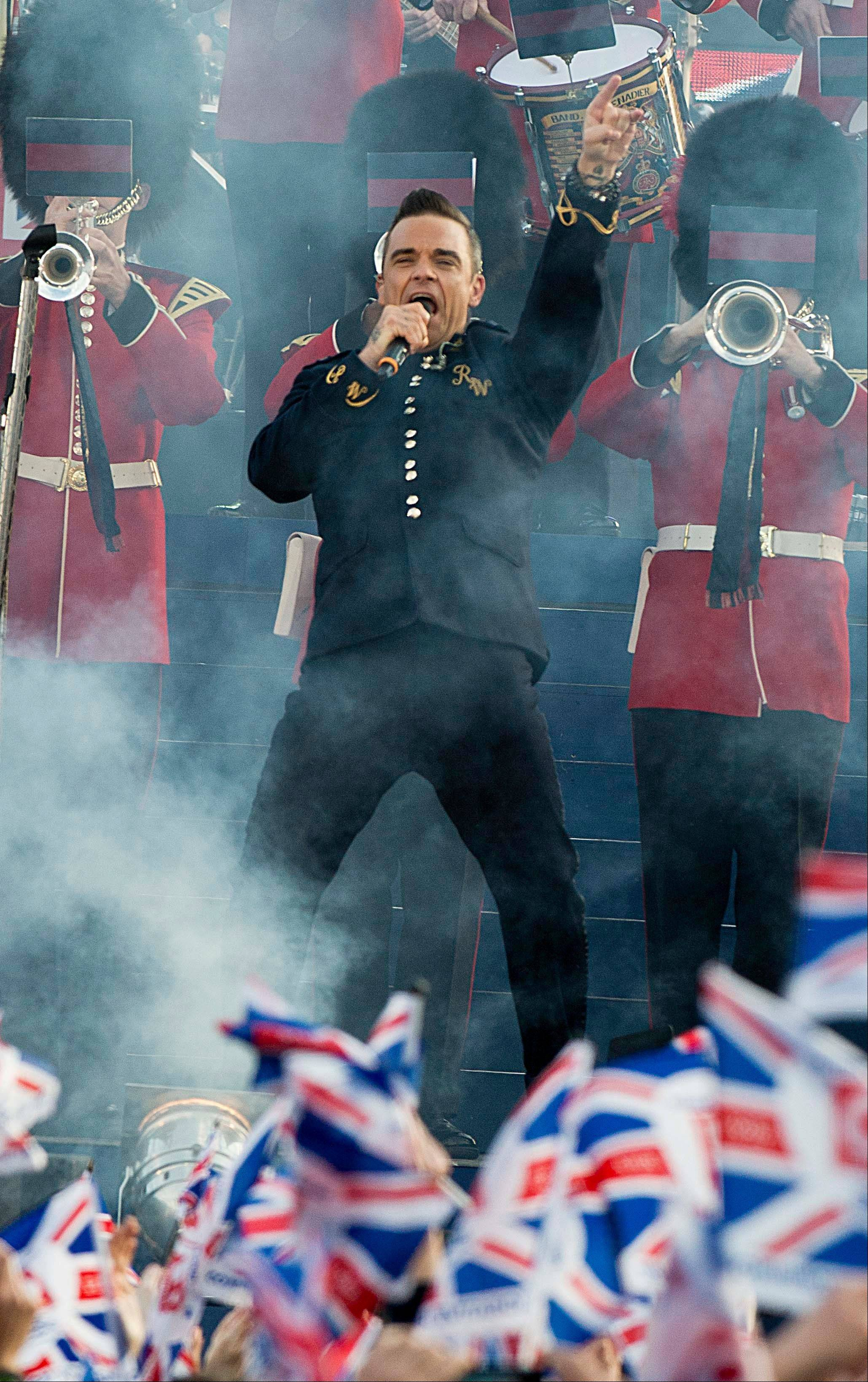 Robbie Williams performs at the Queen's Jubilee Concert in front of Buckingham Palace, London, Monday, June 4, 2012. The concert is a part of four days of celebrations to mark the 60-year reign of Britain's Queen Elizabeth II.