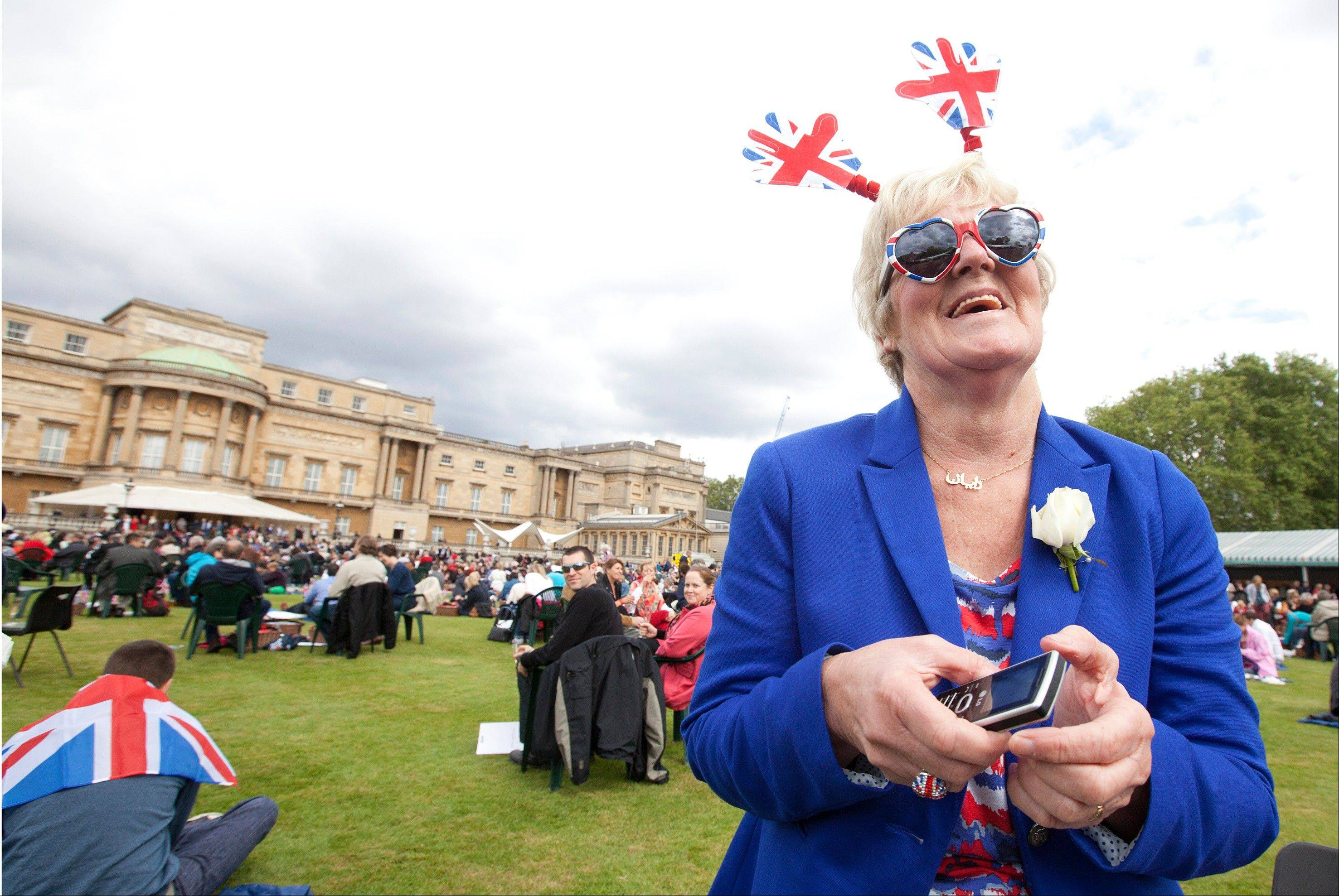 Diane Dourish from Anick in the north of England enjoys the special picnic in the grounds of Buckingham Palace prior to the Queen's Diamond Jubilee celebration concert in London, Monday, June 4, 2012.