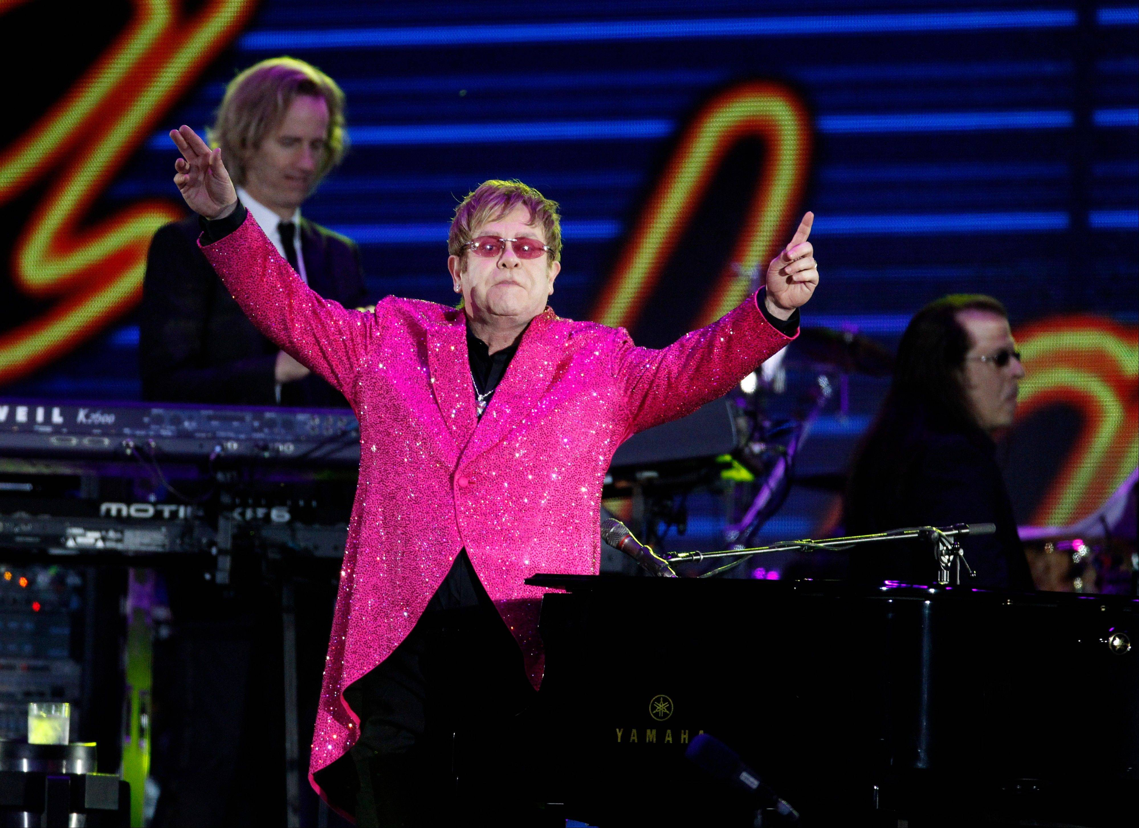 Sir Elton John performs at the Queen's Jubilee Concert in front of Buckingham Palace, London, Monday, June 4, 2012. The concert is a part of four days of celebrations to mark the 60-year reign of Britain's Queen Elizabeth II.