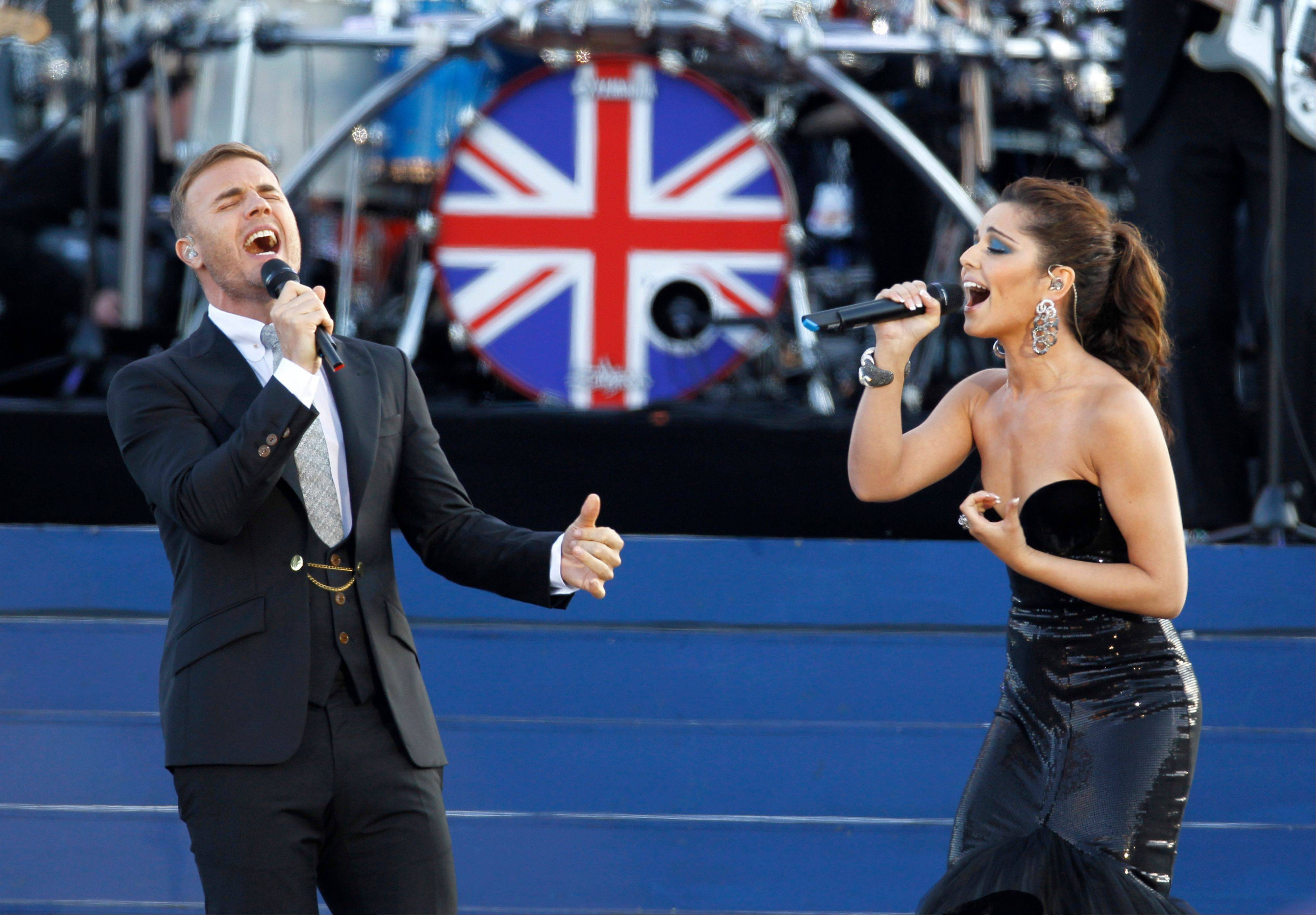 Gary Barlow and Cheryl Cole perform at the Queen's Jubilee Concert in front of Buckingham Palace, London, Monday, June 4, 2012. The concert is a part of four days of celebrations to mark the 60-year reign of Britain's Queen Elizabeth II.