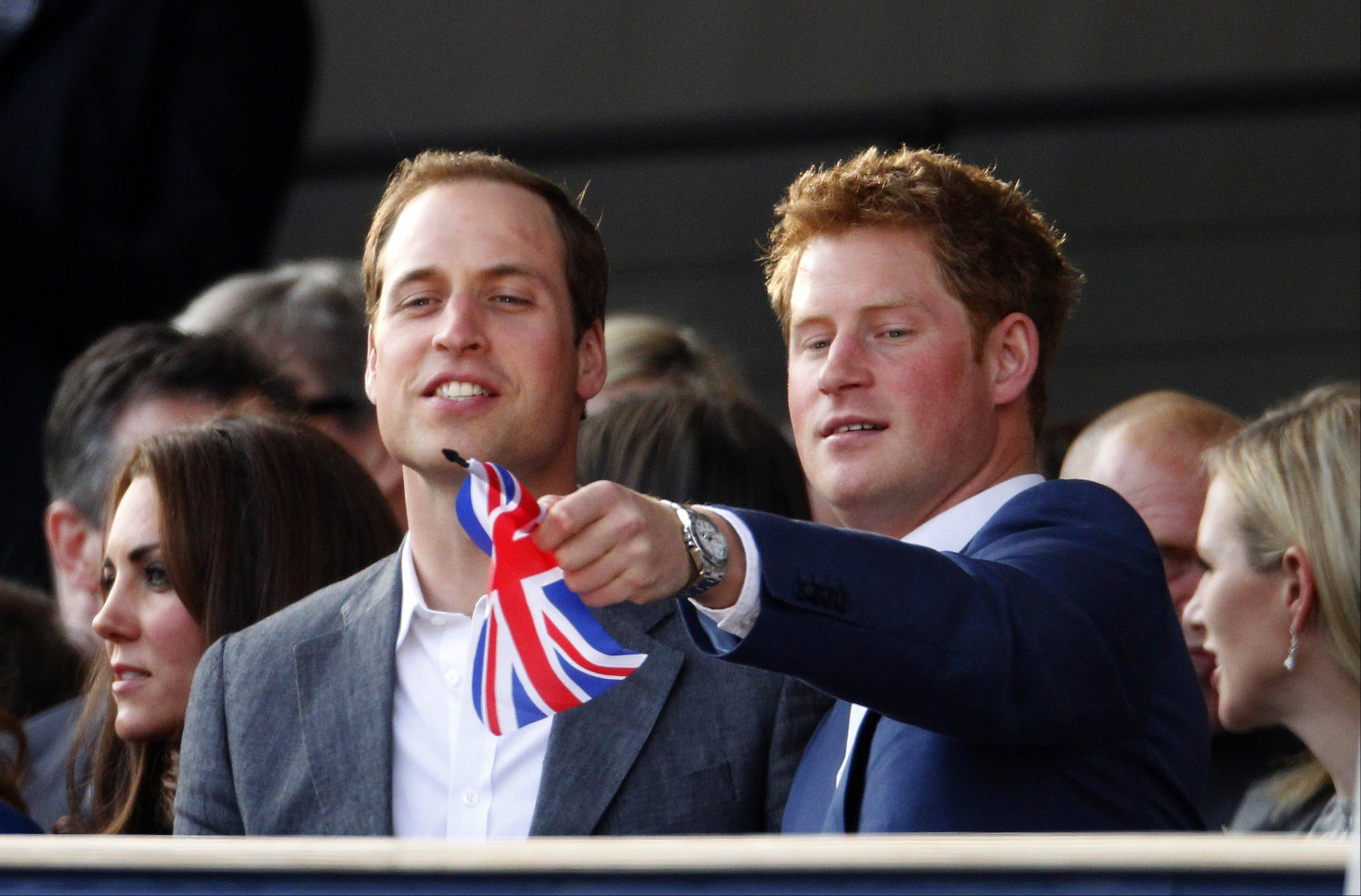 The Duke of Cambridge with Prince Harry, right, attend the Diamond Jubilee concert in London Monday June 4, 2012. Thousands of flag-waving fans gathered to watch British music royalty celebrate Queen Elizabeth II on Monday with a Buckingham Palace concert featuring acts from throughout her 60-year-reign. But the queen's husband, Prince Philip, missed the concert after being hospitalized with a bladder infection. (