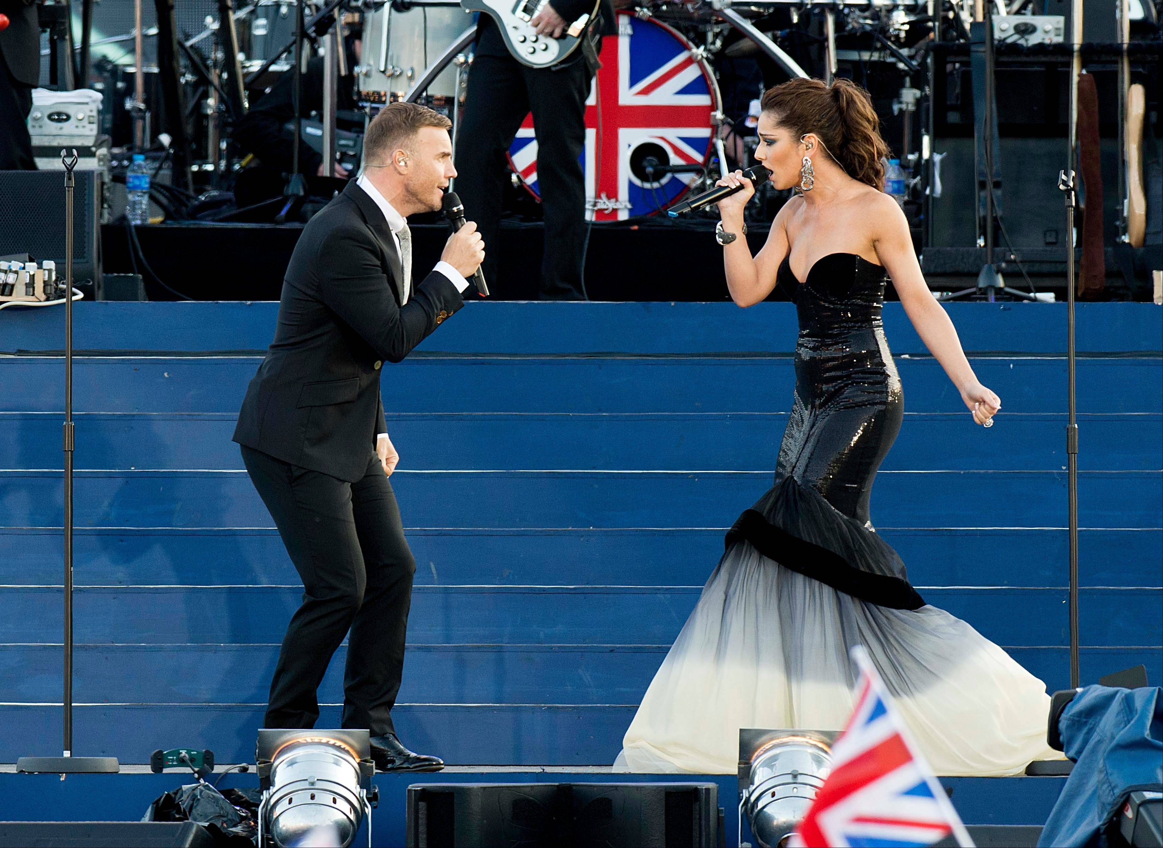 Cheryl Cole and Gary Barlow perform at the Queen's Jubilee Concert in front of Buckingham Palace, London, Monday, June 4, 2012. The concert is a part of four days of celebrations to mark the 60-year reign of Britain's Queen Elizabeth II.