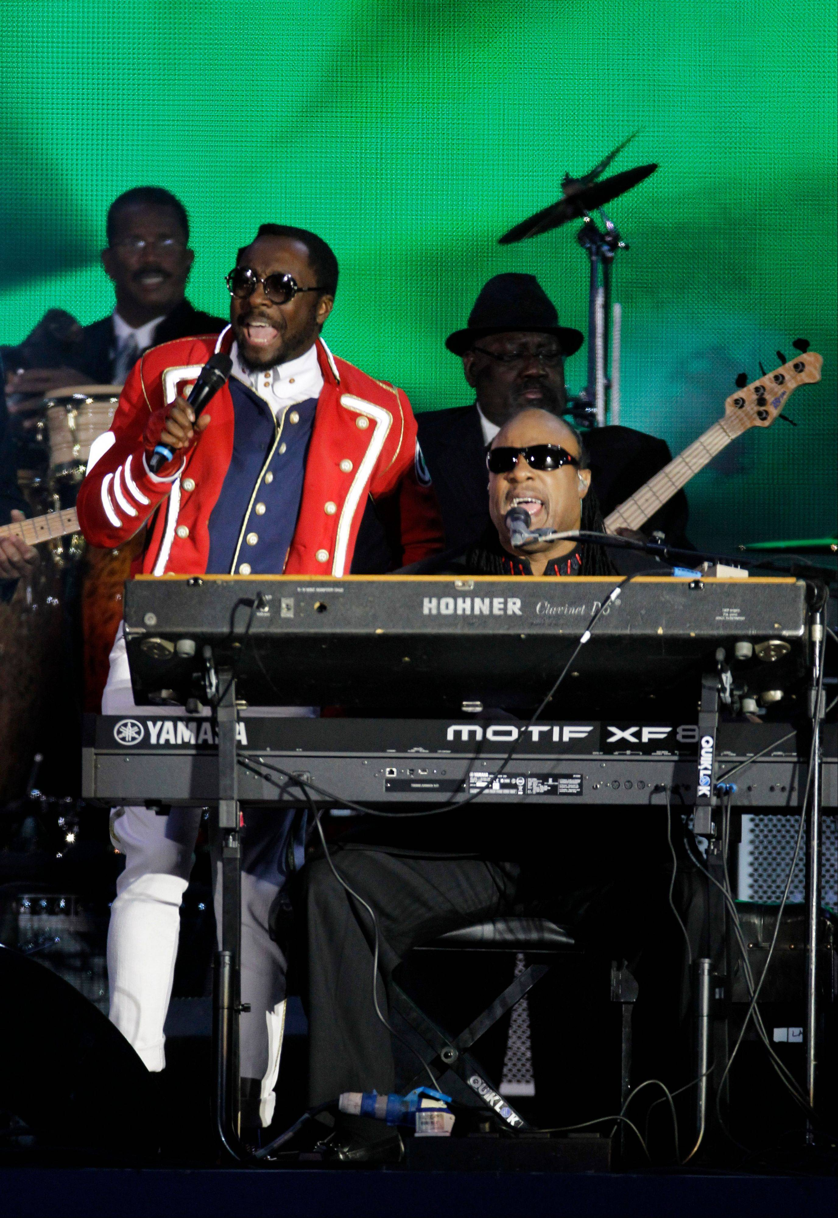 Will.i.am and Stevie Wonder perform at the Queen's Jubilee Concert in front of Buckingham Palace, London, Monday, June 4, 2012. The concert is a part of four days of celebrations to mark the 60-year reign of Britain's Queen Elizabeth II.