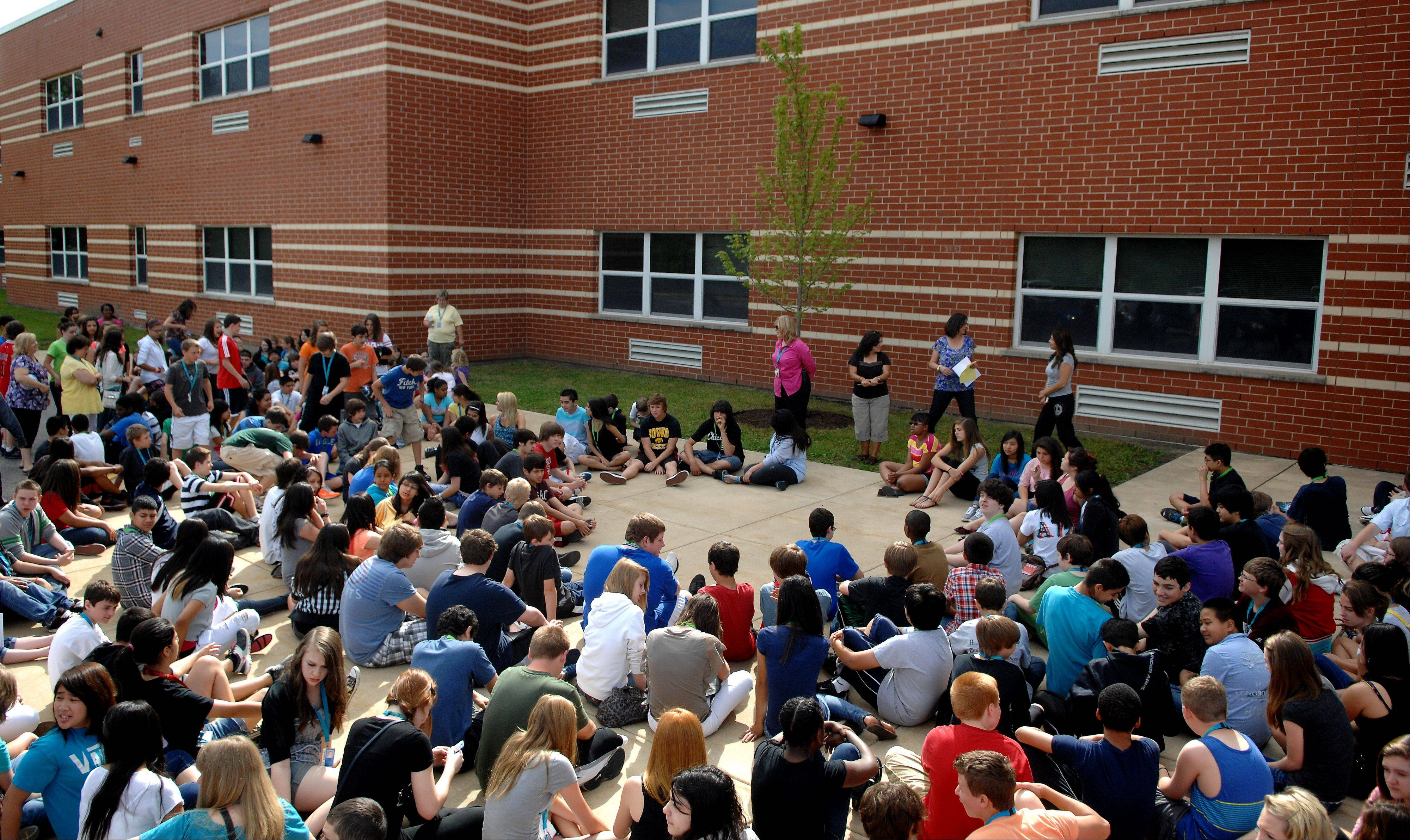 Students and faculty gather for a ceremony Monday for Kenyon Woods Middle School Principal Sue Welu, who is retiring this month. She was the school's first and only principal.