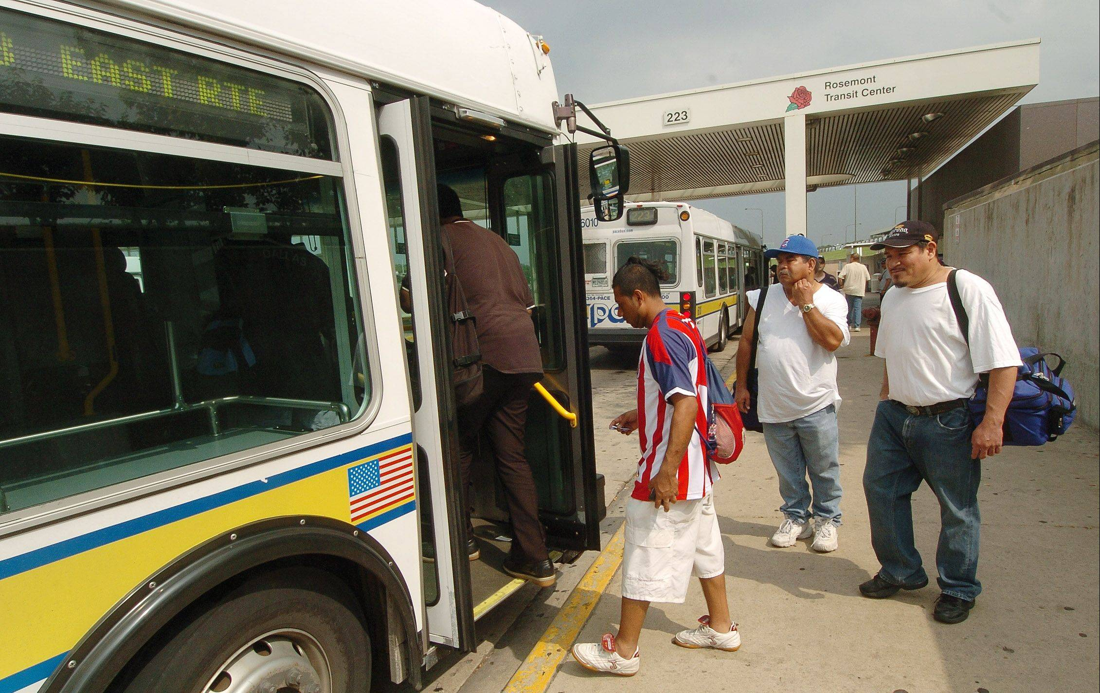 Pace riders board a bus at the Rosemont CTA and Pace bus terminal. The RTA wants the agencies to consolidate overlapping routes.