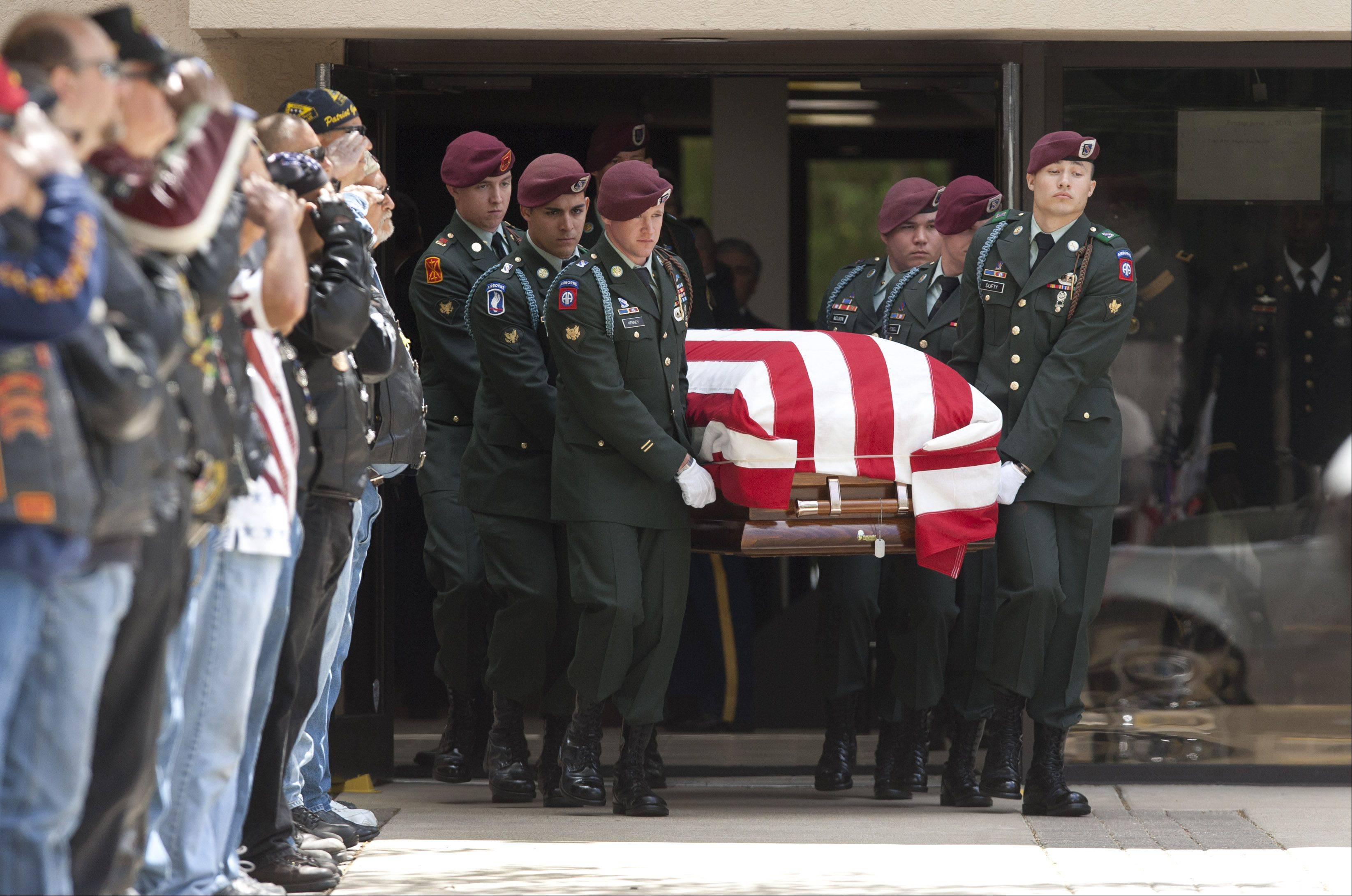 U.S. Army Spc. Samuel Watts, 20, a 2010 Wheaton North High School graduate, is laid to rest following a service at St. John Lutheran Church in downtown Wheaton. He died April 25, about a month after suffering wounds from an explosion while serving in Afghanistan.