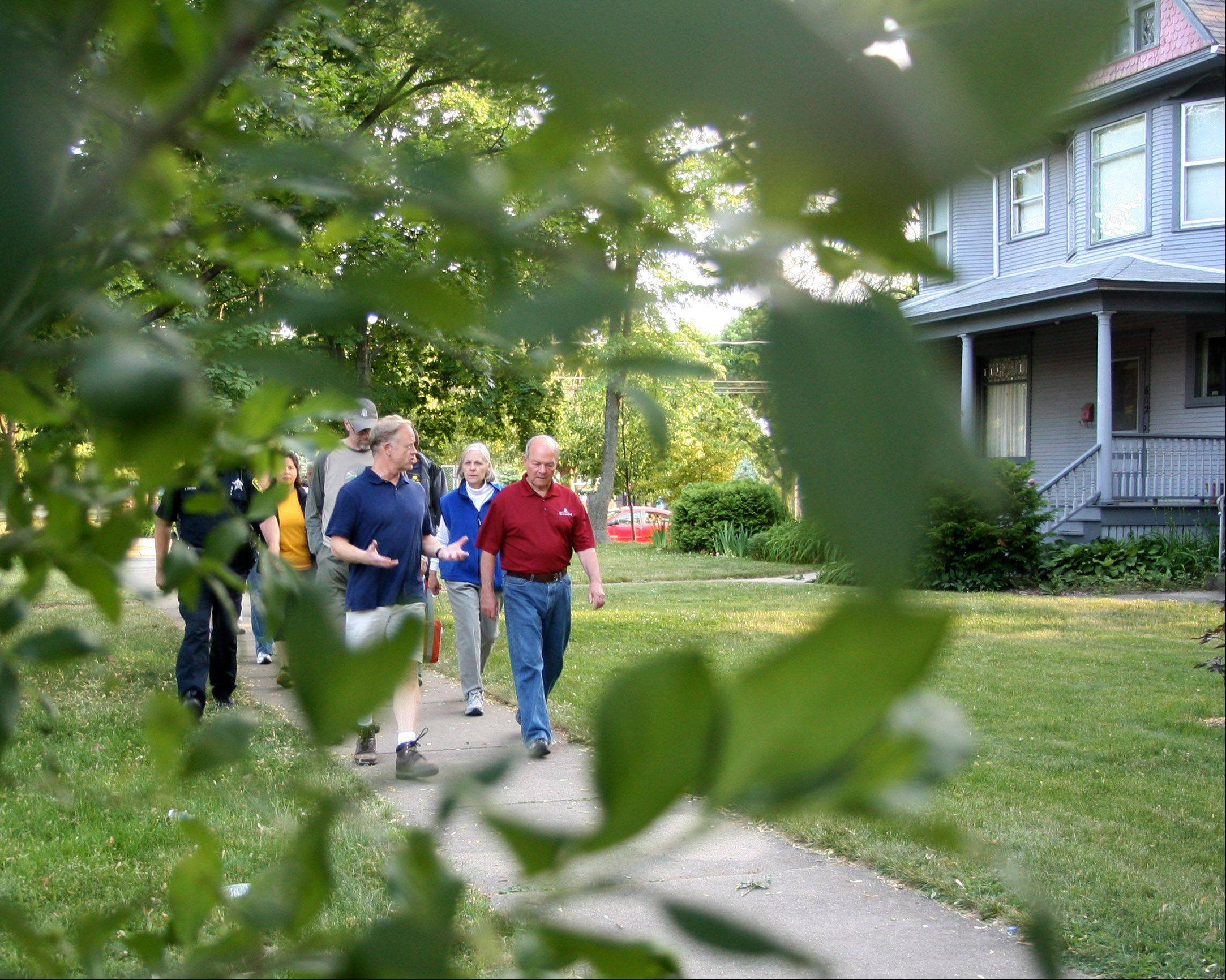 "Elgin Mayor David Kaptain leads a ""Walk with the Mayor"" near St. Francis Park on Wednesday night. The walk was the first of several similar walks planned this summer in an effort to encourage regular exercise."