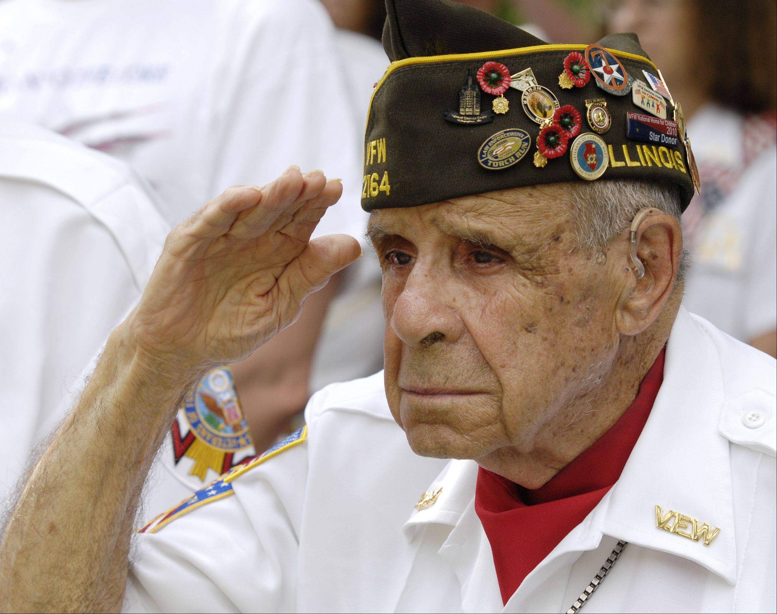 Veterans of Foreign Wars Post 2164 member Louis Licastro a World War II Army Air Corp veteran who survived the Japanese attach on Pearl Harbor in 1941, gives a salute during the Wheaton Memorial Day ceremony at Wheaton Cemetery, Monday.