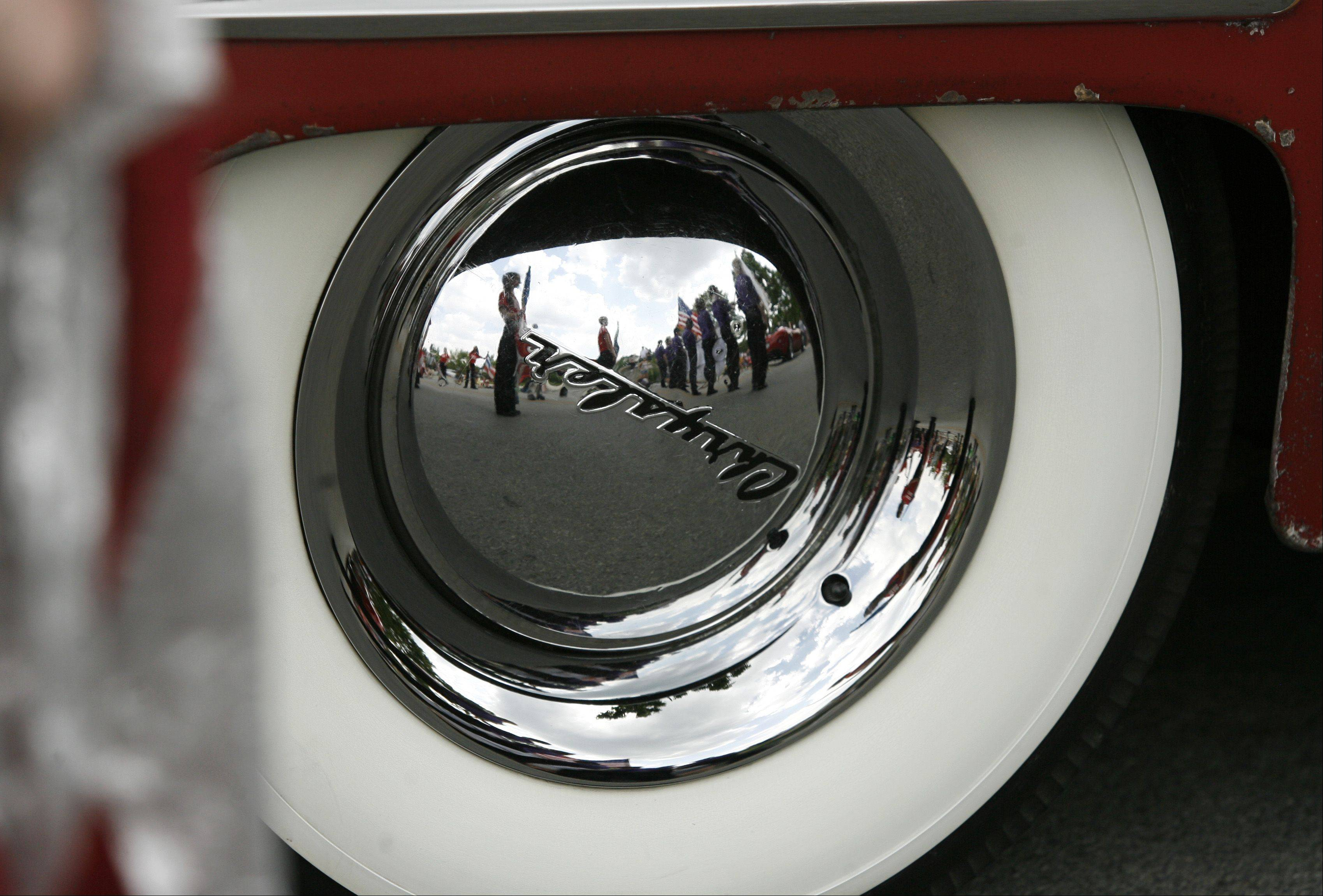 The chrome is thick on the wheels of this 1946 Chevrolet Town and Country, during the Naperville Memorial Day parade.