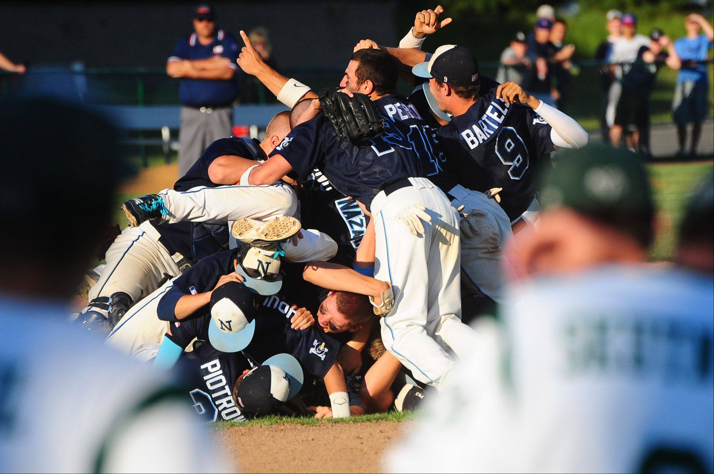 The Nazareth Academy baseball team celebrates its 7-2 win over Grayslake Central on Monday.