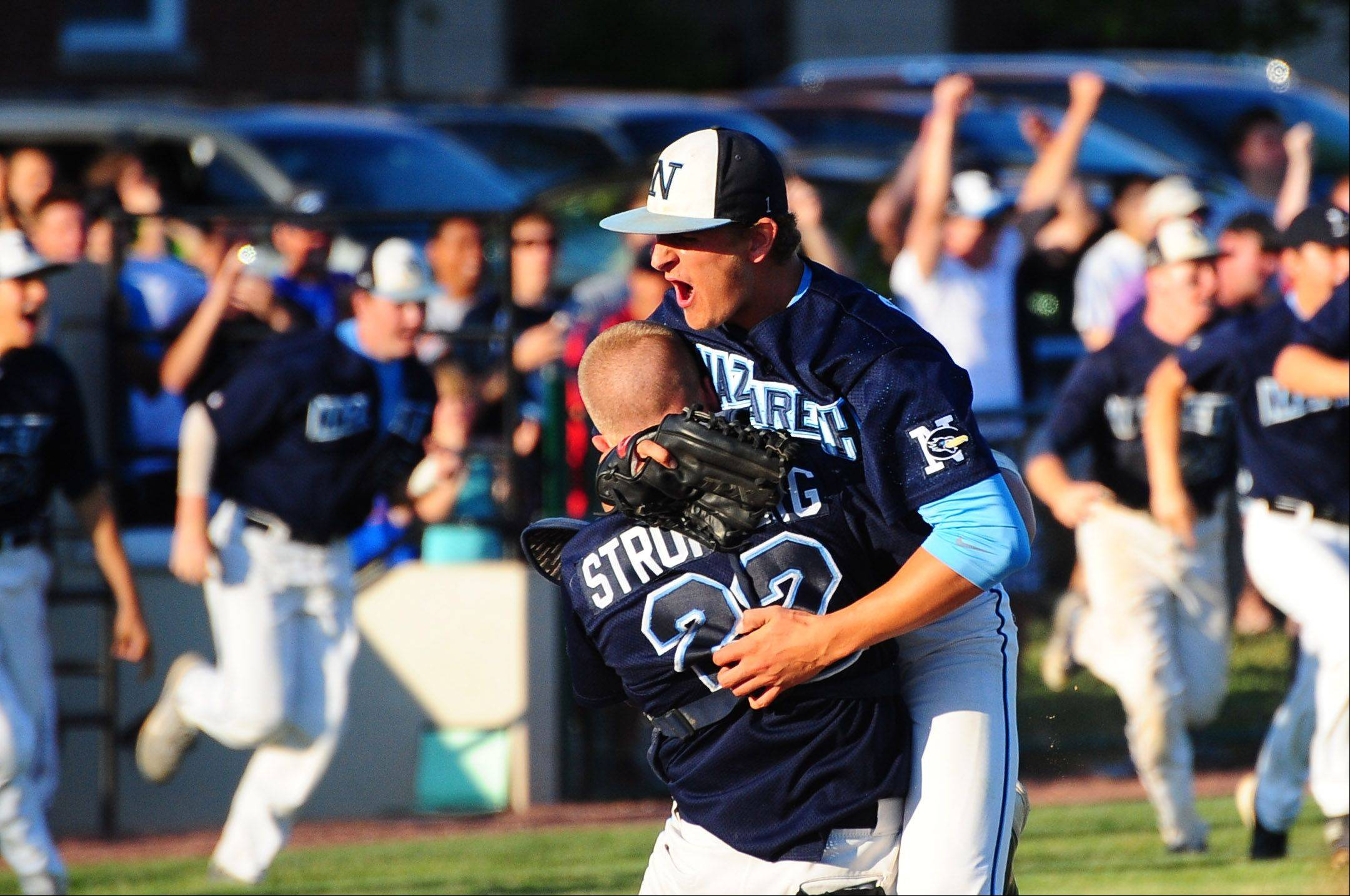 Nazareth pitcher Dominic Purpura celebrates with catcher Mike Stromberg after the final out in Roadrunners' 7-2 victory over Grayslake Central in Class 3A baseball supersectional action Monday.