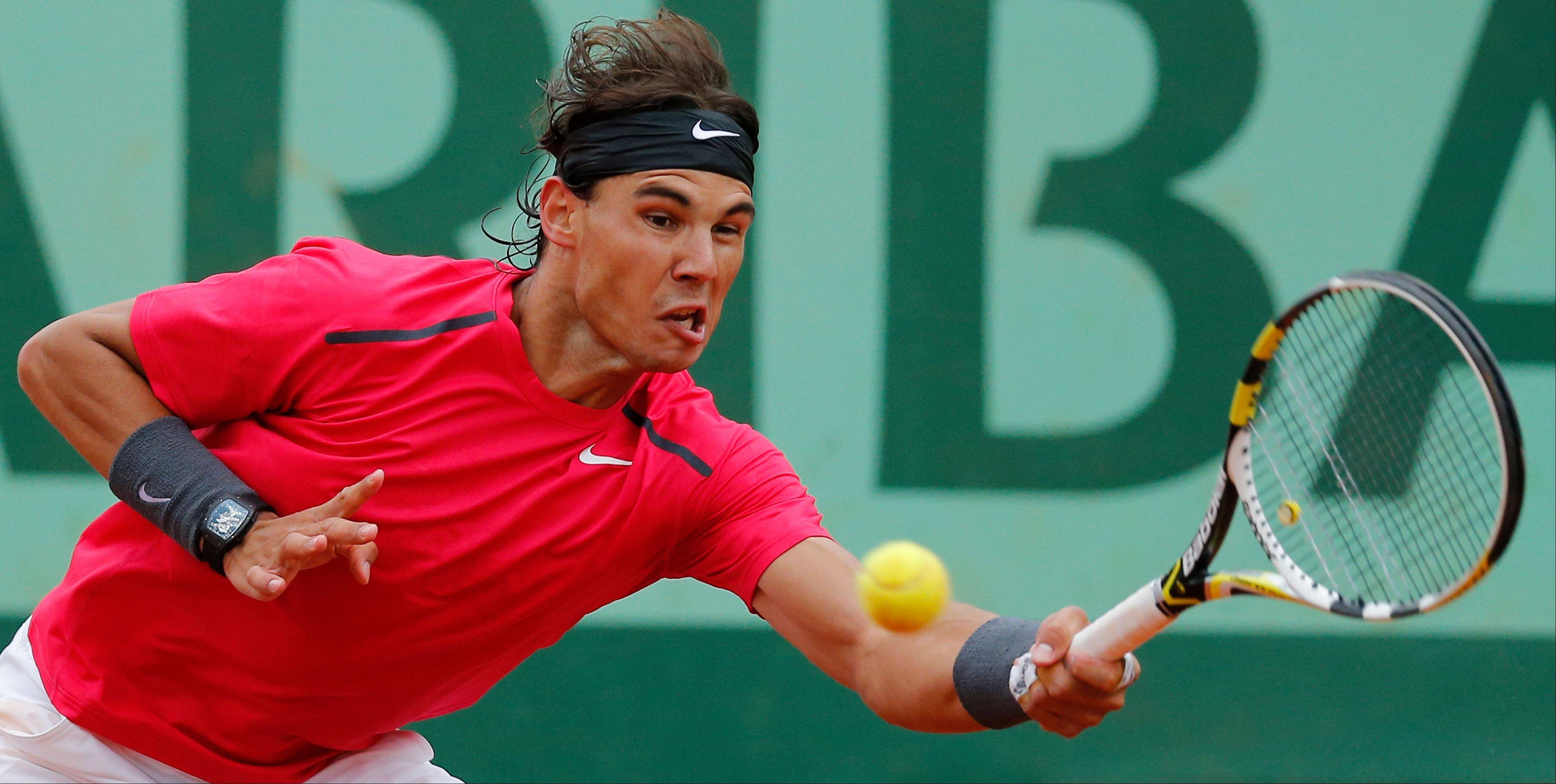 Rafael Nadal of Spain returns in his fourth round match Monday against Juan Monaco of Argentina at the French Open tennis tournament in Roland Garros stadium in Paris. Nadal won in three sets 6-2, 6-0, 6-0, and will go on the play the quarter finals.