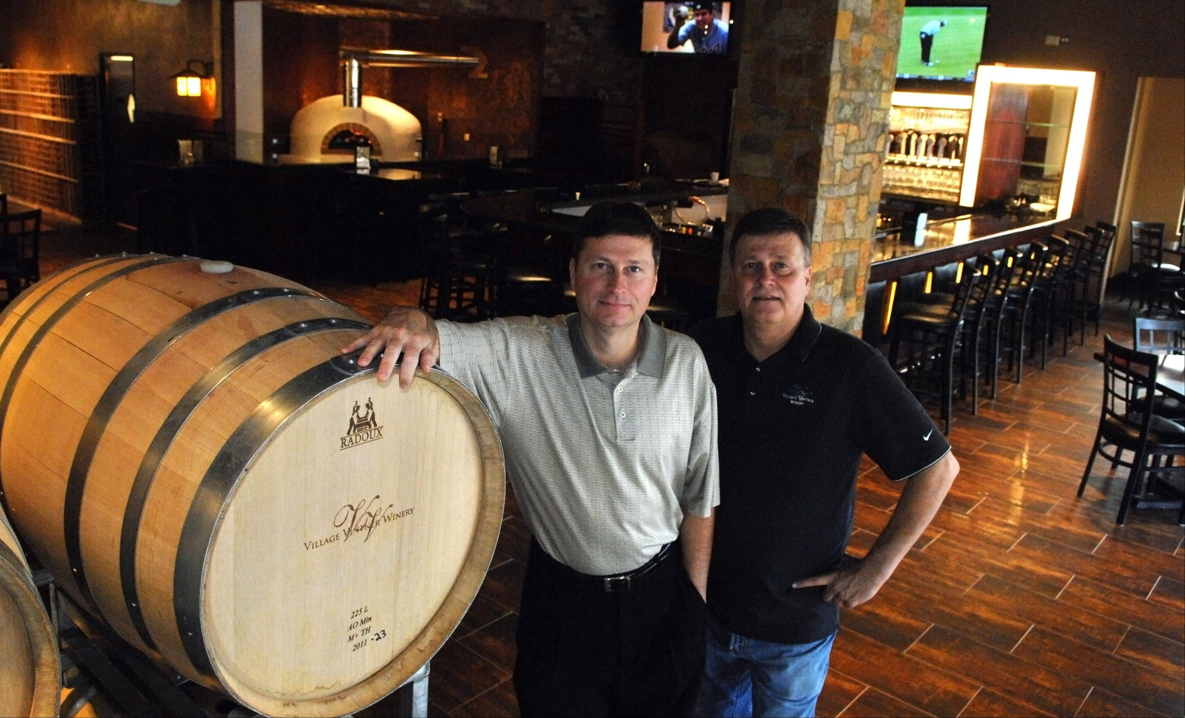 Bob, left, and Steve Boyer of The Village Vintner Winery and Brewery in Algonquin. The winery is now a full-service restaurant with a brewery as well, and has reopened in a new location.