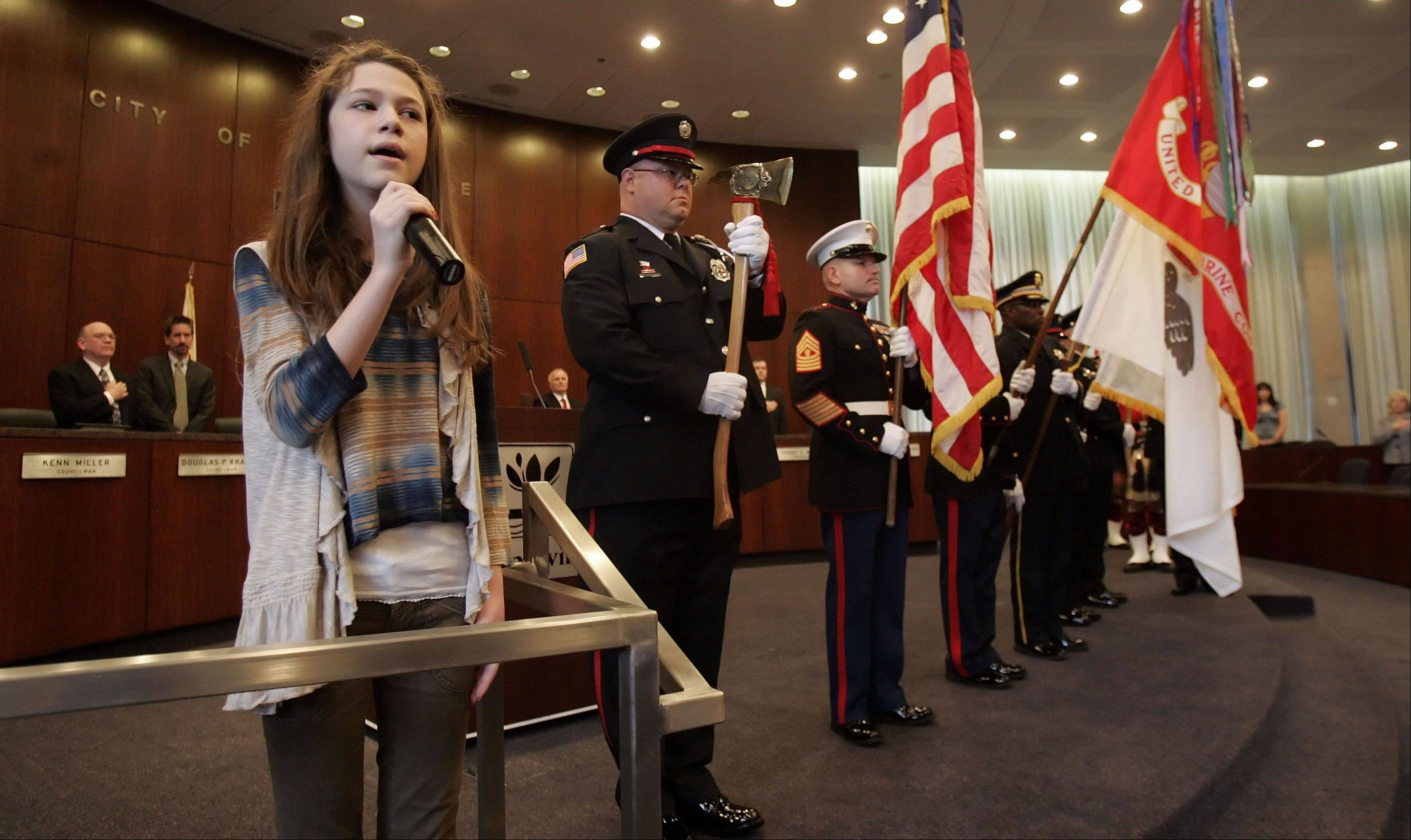 Last year, Shealeigh Voitl, 13, of Barlett, sang the national anthem during the inauguration ceremony in the council chambers of the Naperville Municipal Center.