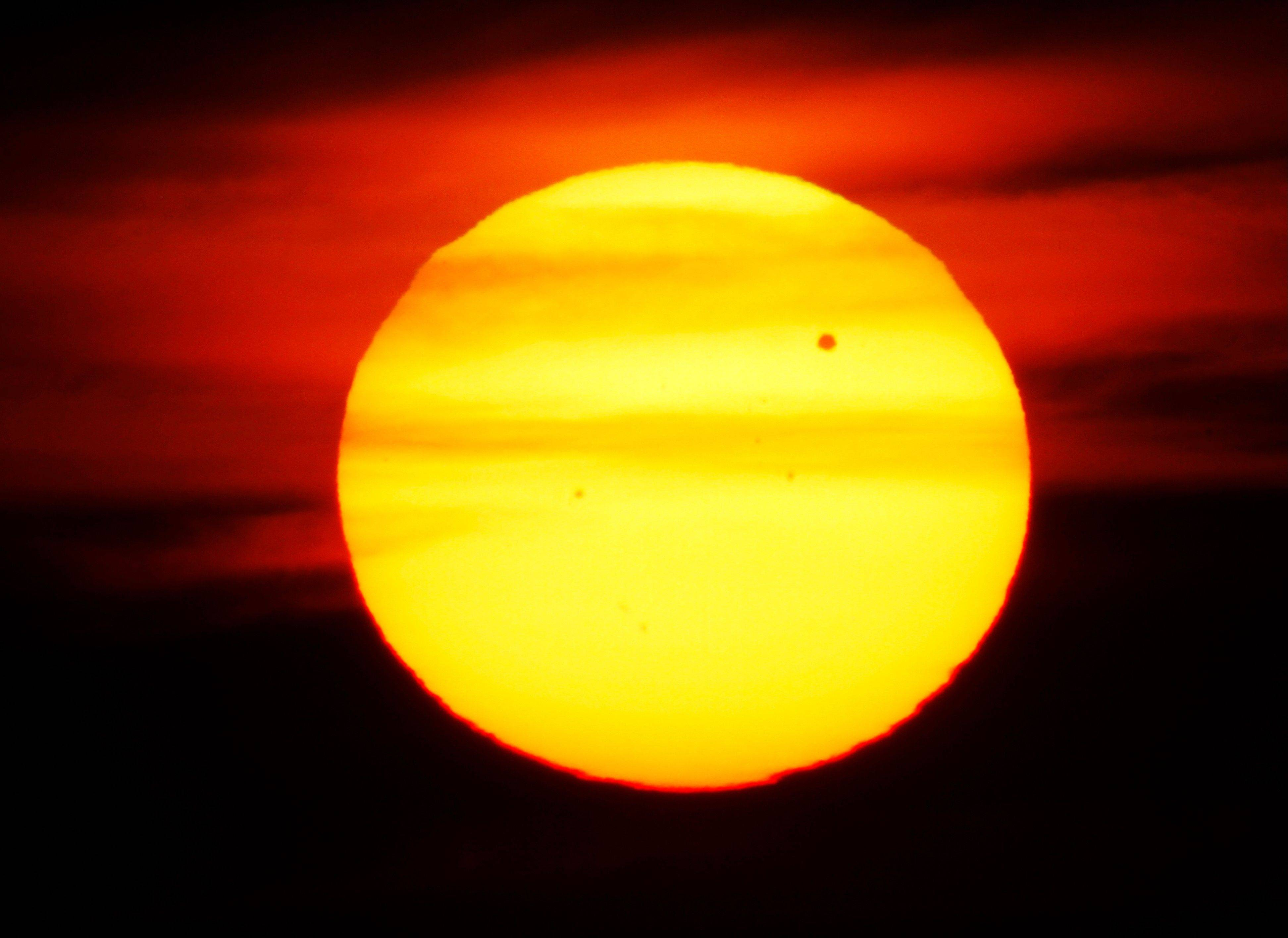 The planet Venus crosses the upper right portion of the sun as seen from Edgewater Park in Cleveland on Tuesday, June 5, 2012. The next transit of Venus won't be for another 105 years.