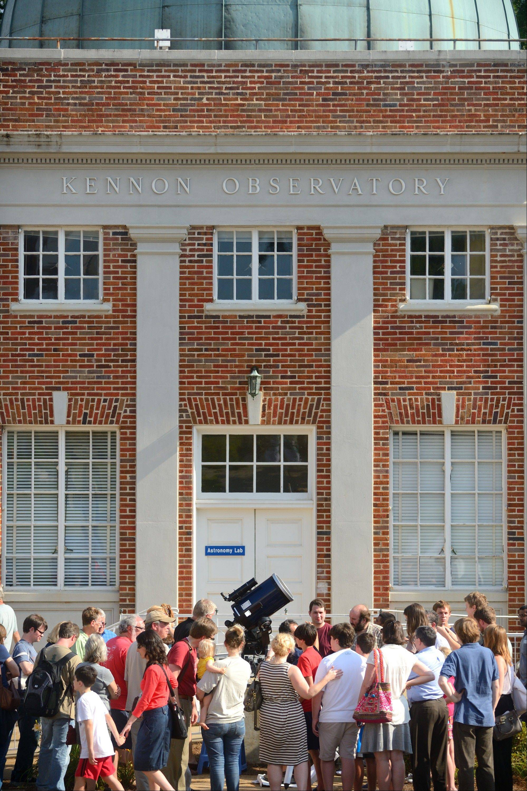 The photo provided by Ole Miss Communications shows astronomy enthusiasts gather to view the transit of Venus in front of the sun at the Kennon Observatory at The University of Mississippi in Oxford, Miss., Tuesday, June 5, 2012.