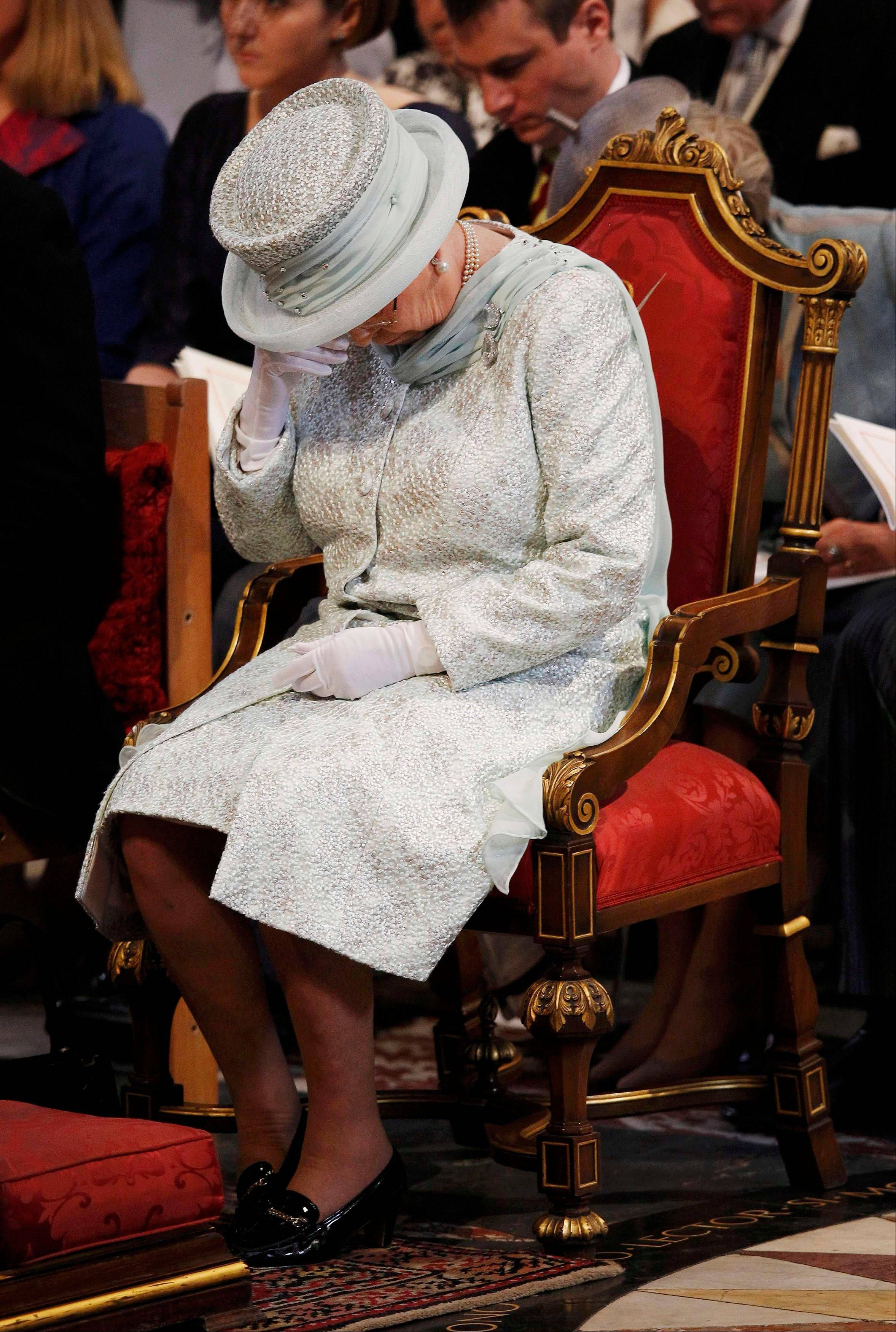Britain's Queen Elizabeth II wipes her eye during a thanksgiving service to celebrate her Diamond Jubilee at St Paul's Cathedral in central London Tuesday June 5, 2012. Four days of nationwide celebrations during which millions of people have turned out to mark Queen Elizabeth's Diamond Jubilee conclude on Tuesday with a church service and carriage procession through central London.