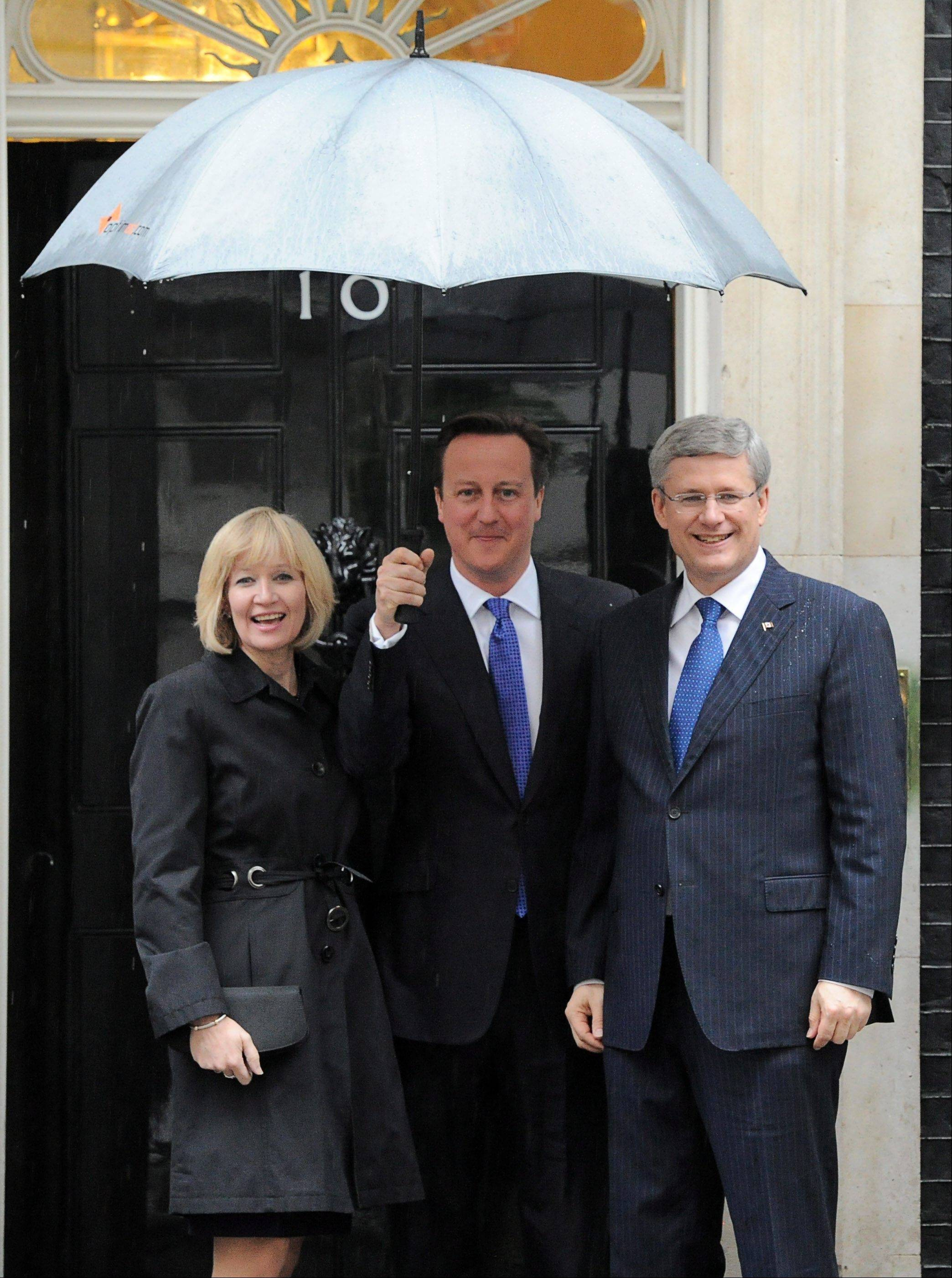 Prime Minister Stephen Harper and wife Laureen are greeted by British Prime Minister David Cameron as they arrive to 10 Downing Street in London on Tuesday, June 5, 2012, during the Queen's Diamond Jubilee. The well-wishers came in all ages, from across Britain and around the world, and many seemed genuinely moved.