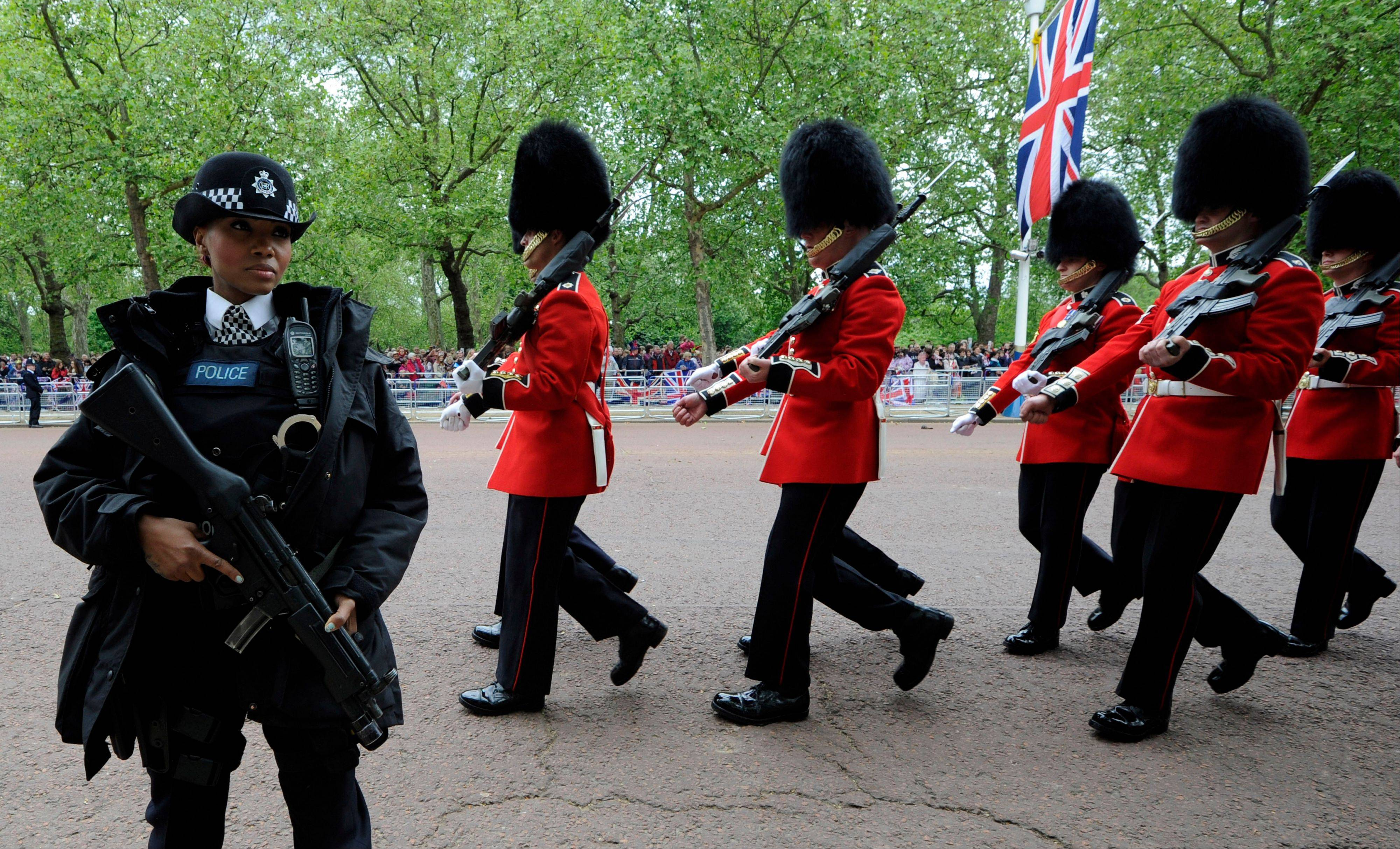 Soldiers move along The Mall to take their positions as part of Queen Elizabeth II Diamond Jubilee celebrations, London, Tuesday June 5, 2012. Queen Elizabeth II will make a rare address to the nation at the conclusion of festivities marking her 60 years on the throne.