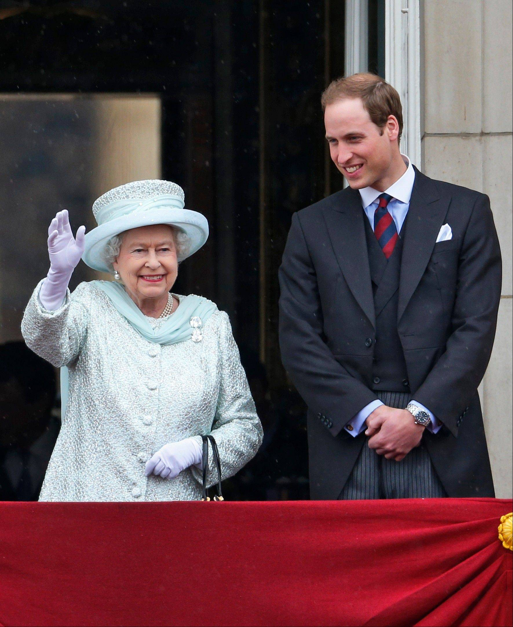 Britain's Queen Elizabeth II accompanied by Prince William appears on the balcony of Buckingham Palace in central London, Tuesday, June 5, 2012, to conclude the four-day Diamond Jubilee celebrations to mark the 60th anniversary of the Queen's accession to the throne.