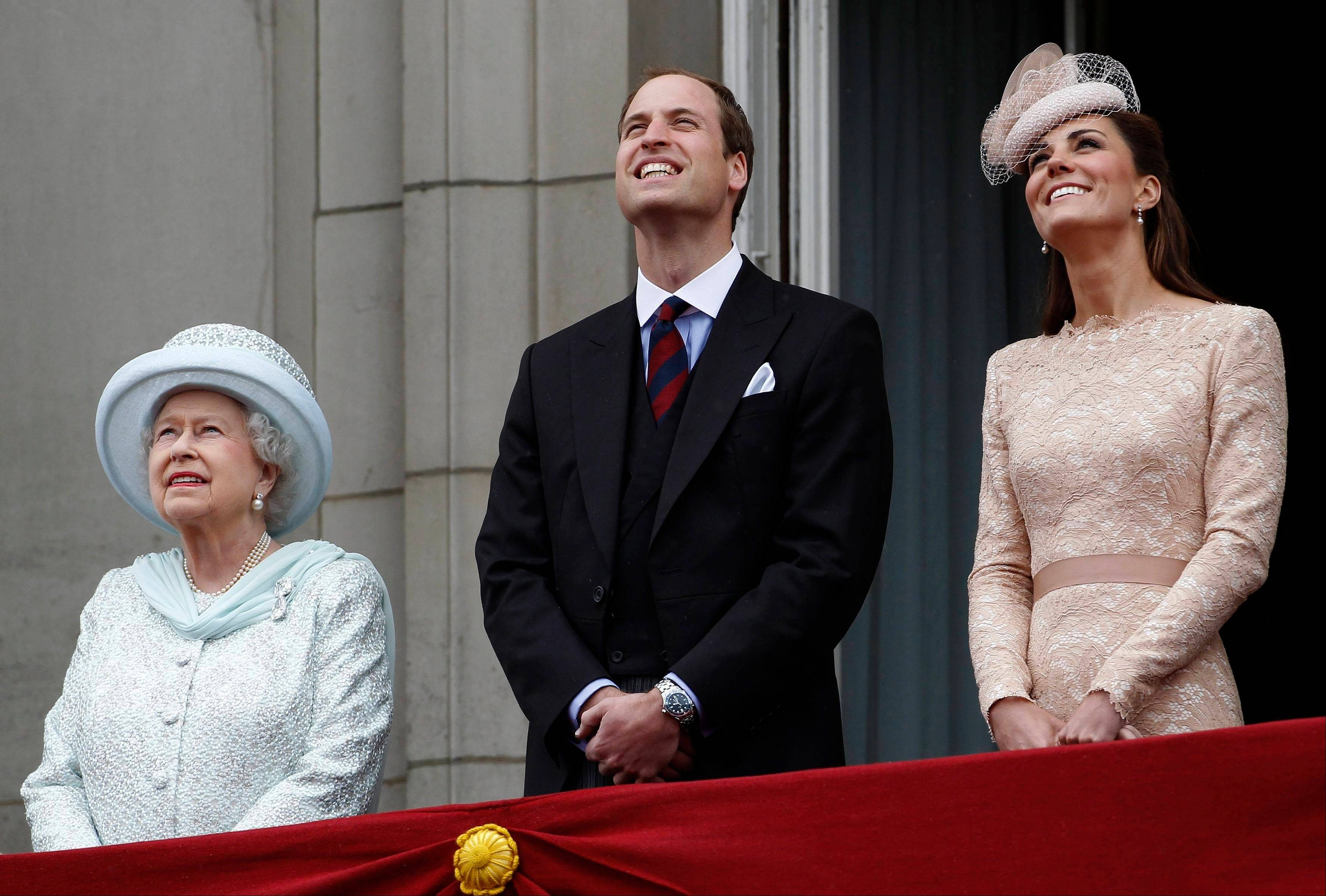 Britain's Queen Elizabeth Prince William, and his wife Kate Duchess of Cambridge, right, look up at a military fly-past as they stand on the balcony at Buckingham Palace during the Diamond Jubilee celebrations in central London Tuesday June 5, 2012. Four days of nationwide celebrations during which millions of people have turned out to mark the Queen's Diamond Jubilee conclude on Tuesday with a church service and carriage procession through central London.