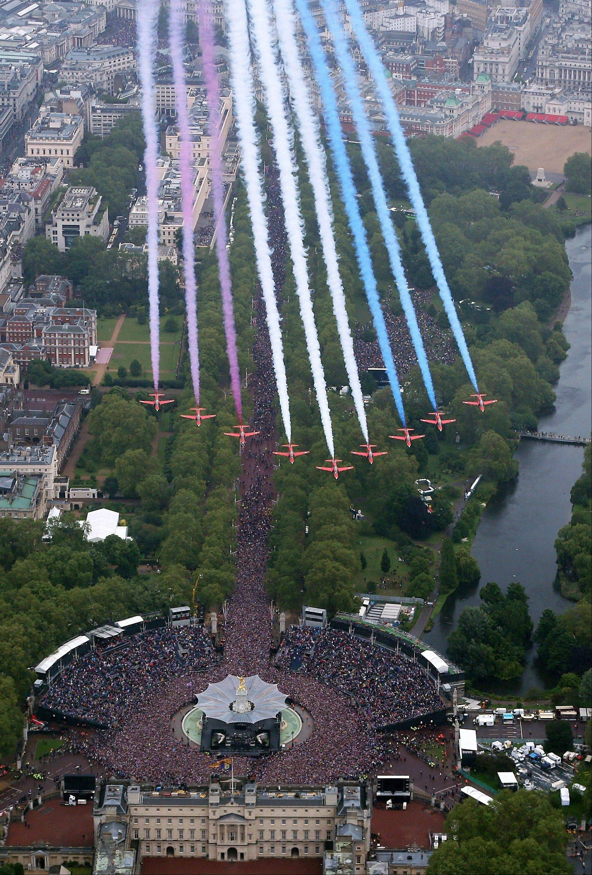 "The British Royal Air Force Red Arrows fly in formation over Buckingham Palace in London to celebrate Queen Elizabeth's Diamond Jubilee as the royal family stood on the balcony Tuesday June 5, 2012. Pealing church bells and crowds cheering ""God save the queen!"" greeted Queen Elizabeth II on Tuesday as she arrived for a service at St. Paul's Cathedral on the last of four days of Diamond Jubilee celebrations honoring her 60 years on the throne."