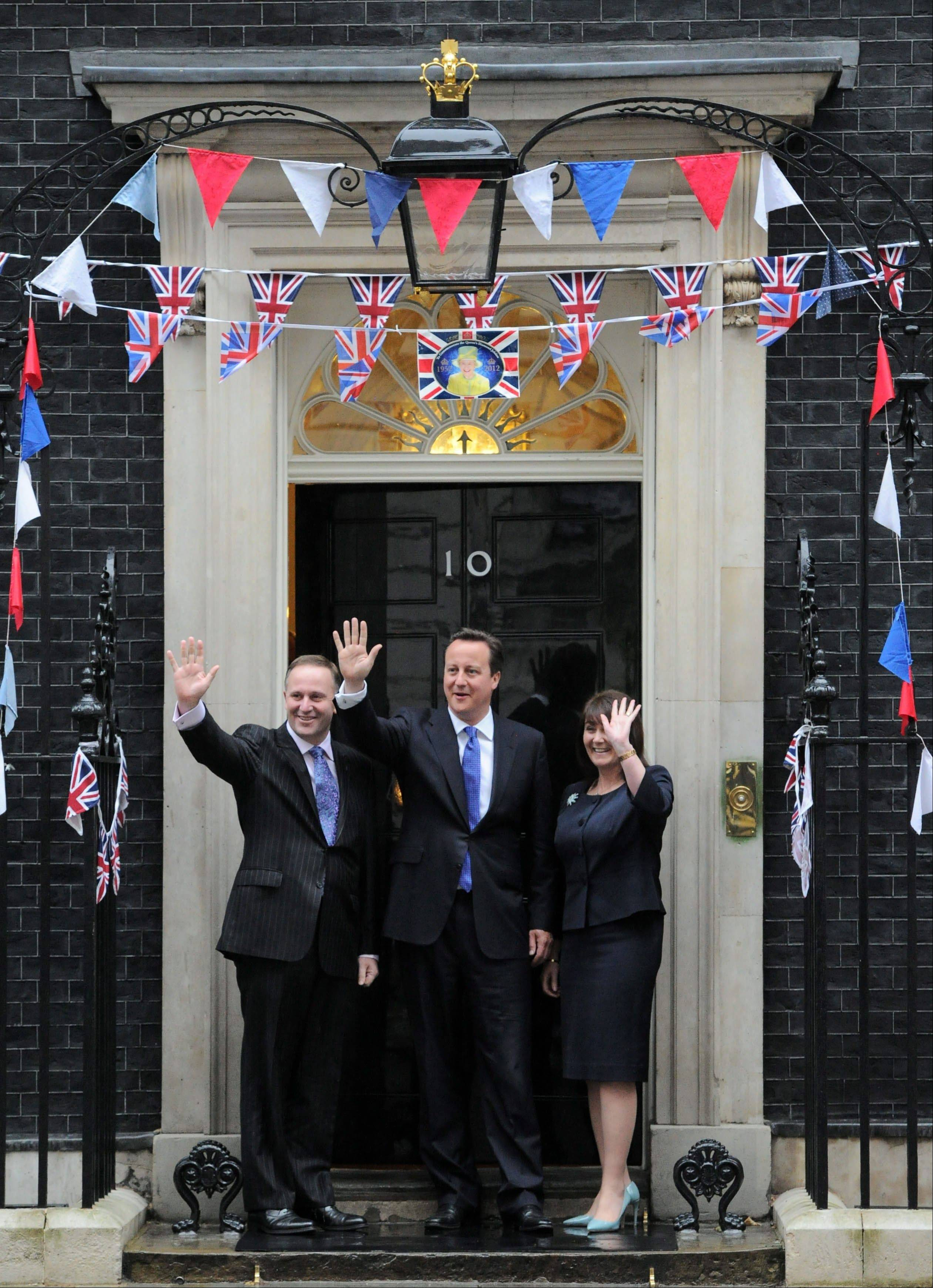 New Zealand Prime Minister John Key and wife Bronagh are greeted by British Prime Minister David Cameron as they arrive to 10 Downing Street in London on Tuesday, June 5, 2012, during the Queen's Diamond Jubilee. The well-wishers came in all ages, from across Britain and around the world, and many seemed genuinely moved.