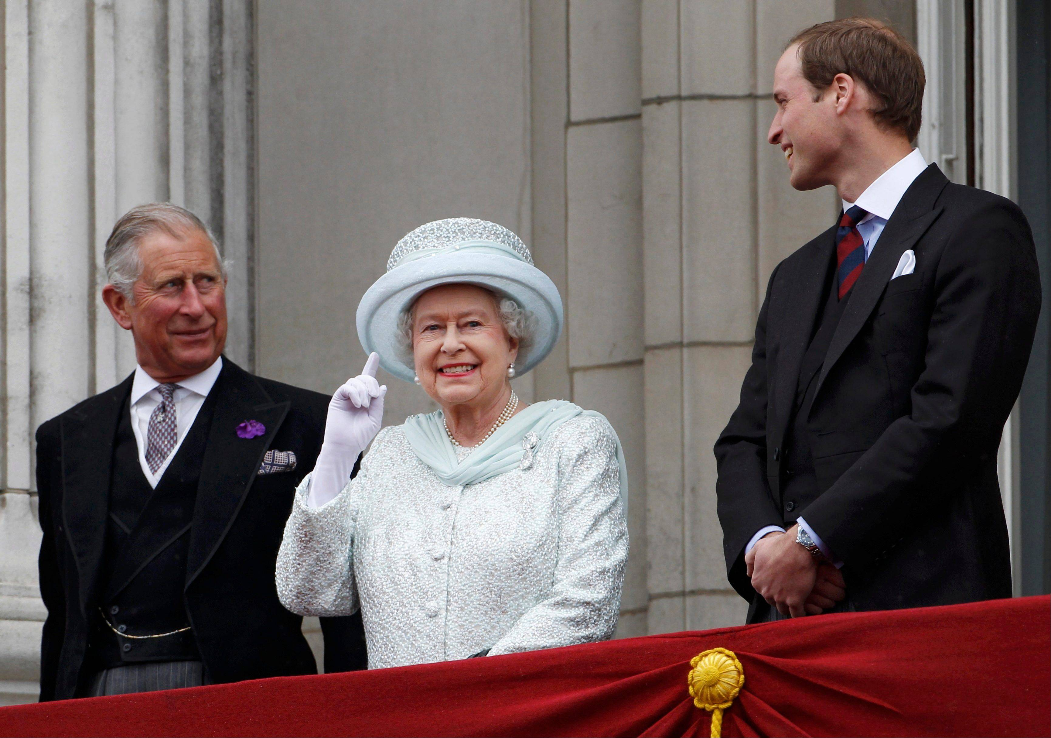 Britain's Prince Charles, Britain's Queen Elizabeth II and Prince William stand on the balcony at Buckingham Palace during the Diamond Jubilee celebrations in central London Tuesday June 5, 2012.
