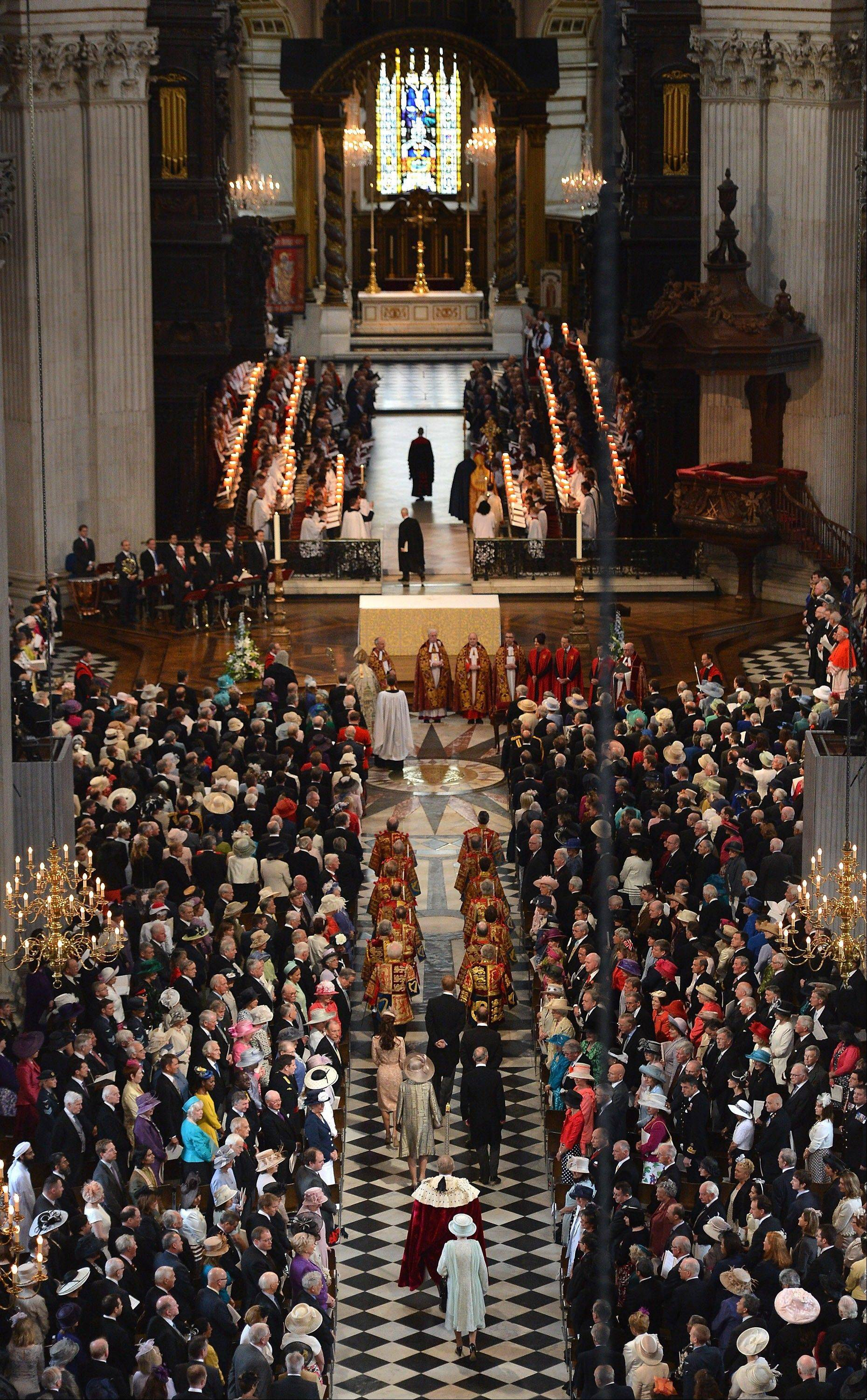 "Britain's Queen Elizabeth II, foreground centre, arrives inside St Paul's Cathedral for a service of thanksgiving during Diamond Jubilee celebrations on Tuesday June 5, 2012 in London. Crowds cheering ""God save the queen!"" and pealing church bells greeted Queen Elizabeth II on Tuesday as she arrived for a service at St. Paul's Cathedral on the last of four days of celebrations of her 60 years on the throne."