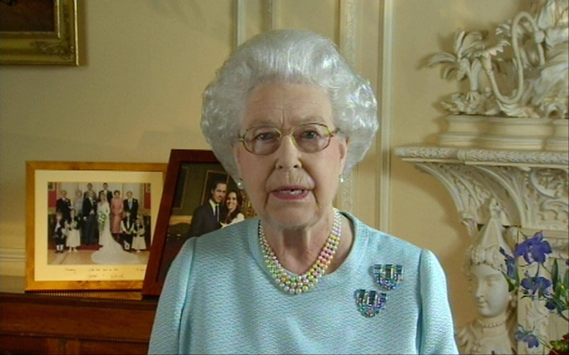 "This image made available by ITN taken from video showsBritain's Queen Elizabeth II addressing the country and Commonwealth, during the Diamond Jubilee celebrations, Tuesday evening, June 5, 2012. The queen recorded the two-minute message on Monday before the evening's concert outside the palace. In the opening of her speech she said ""The events that I have attended to mark my Diamond Jubilee have been a humbling experience. It has touched me deeply to see so many thousands of families, neighbours and friends celebrating together in such a happy atmosphere""."