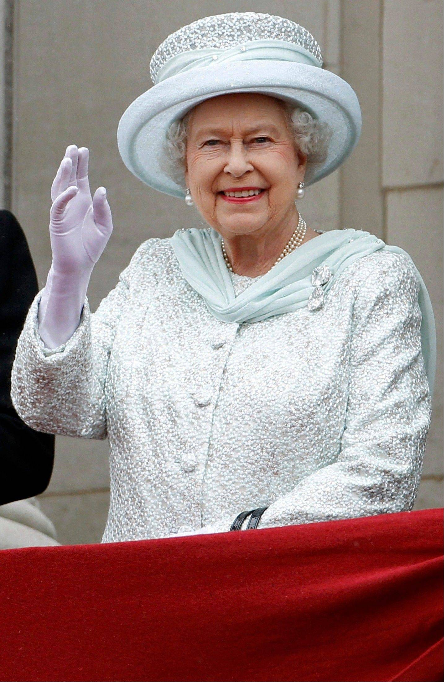 Britain's Queen Elizabeth waves from the balcony at Buckingham Palace during the Diamond Jubilee celebrations in central London Tuesday June 5, 2012. Four days of nationwide celebrations during which millions of people have turned out to mark the Queen's Diamond Jubilee conclude on Tuesday with a church service and carriage procession through central London.