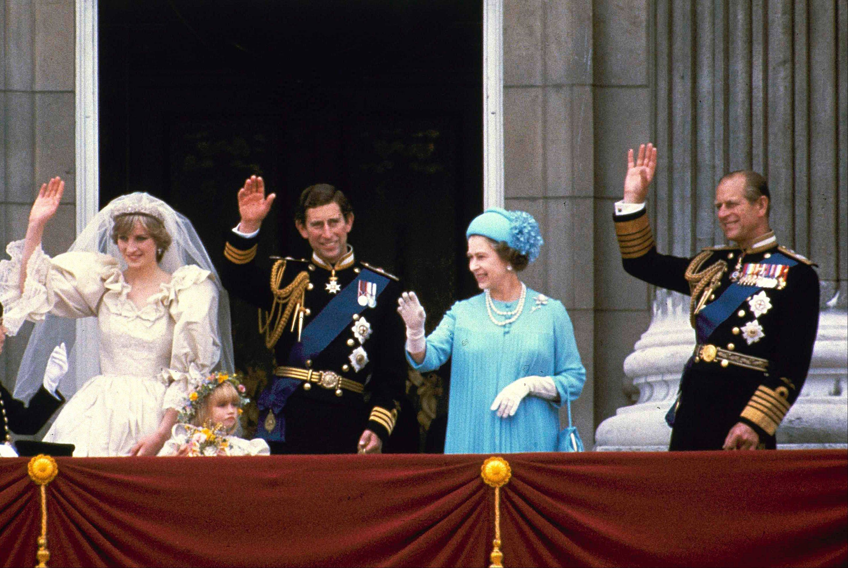 In this July 29, 1981, photo, Prince Charles and his bride Diana, Princess of Wales, and his parents, Queen Elizabeth II and Prince Phillip, wave from the balcony of Buckingham Palace in London after their marriage at St. Paul's Catheral.