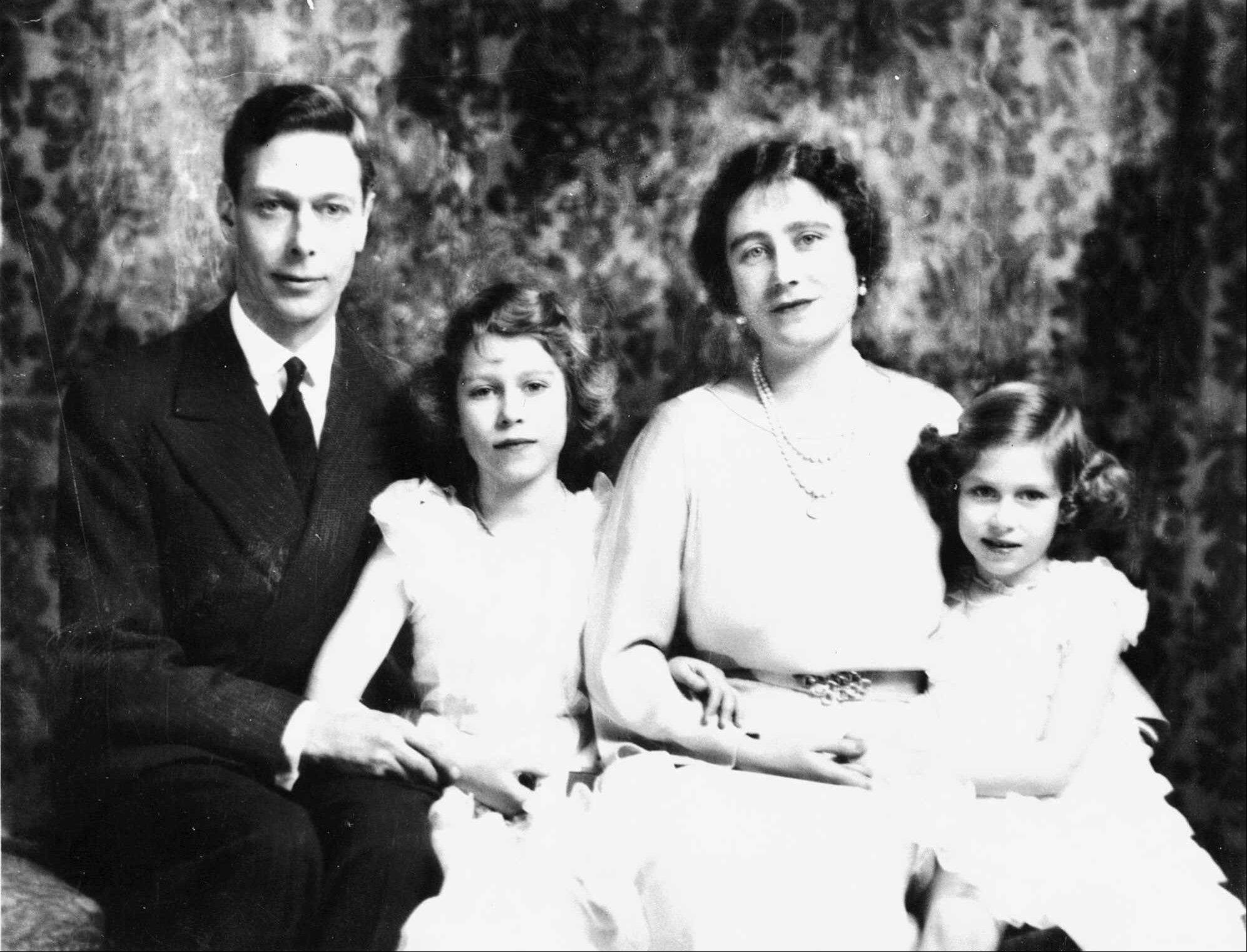 In this 1937 photo, Britain's Queen Elizabeth, the Queen Mother, poses with her husband, King George VI, and their two daughters, Princess Elizabeth, the future Queen Elizabeth II, center, and Princess Margaret.