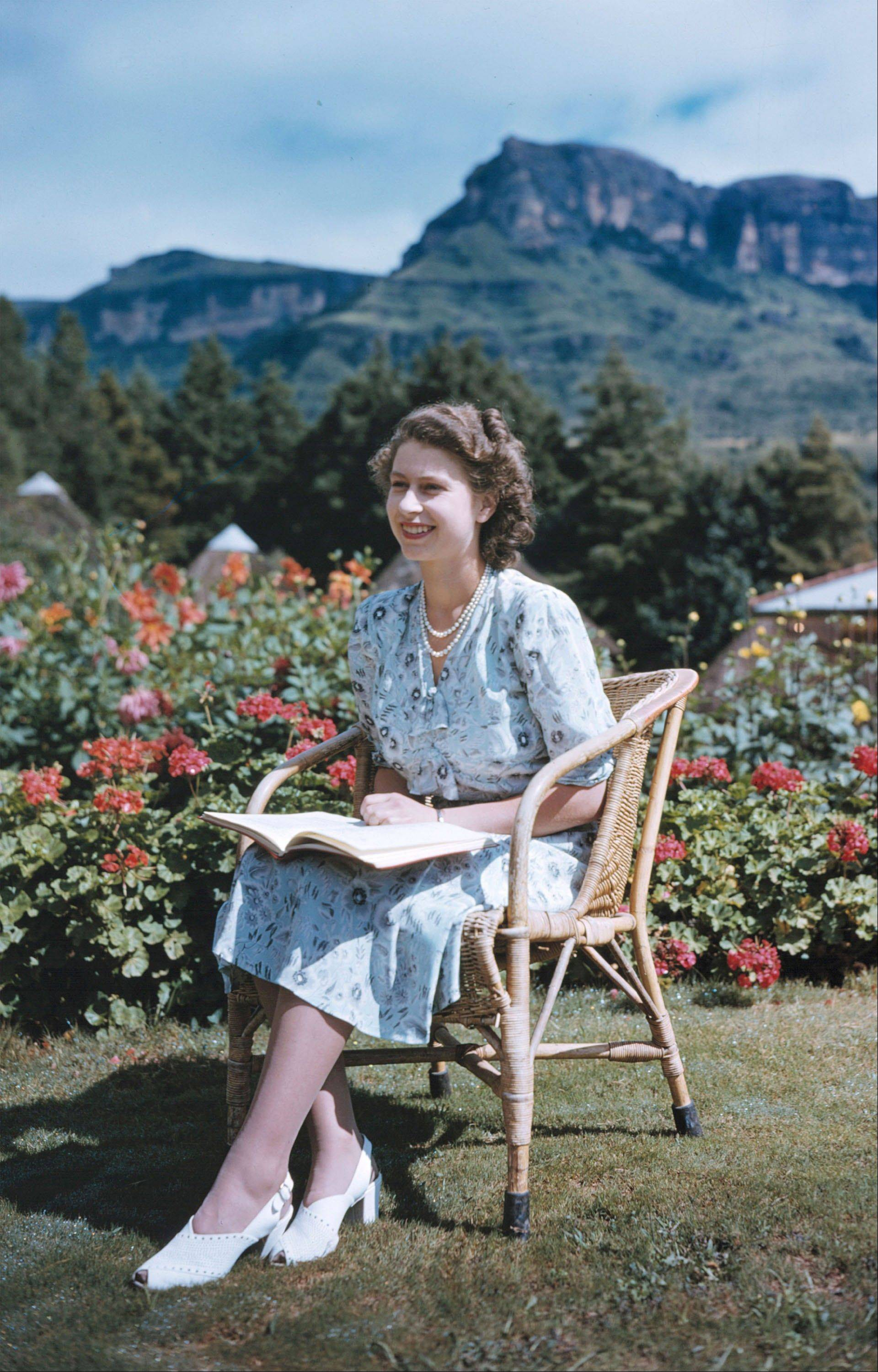 In this April 21, 1947, photo, Britain's Princess Elizabeth, later Queen Elizabeth II, sits at Natal National Park in South Africa, on her 21st birthday.
