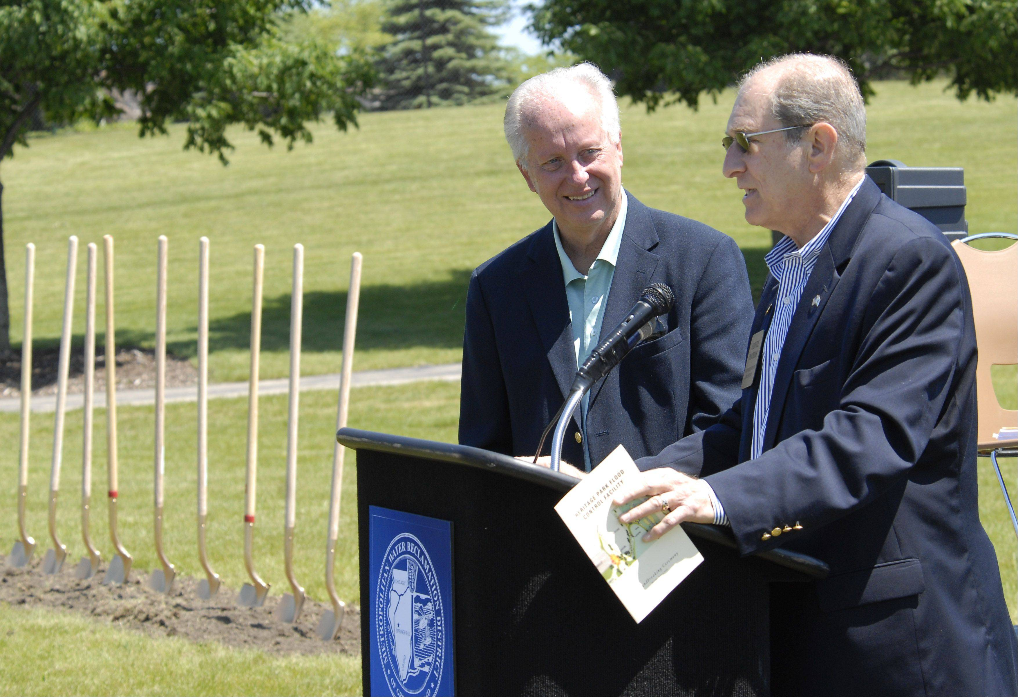 State Rep. Sid Mathias speaks as state Sen. Terry Link looks on, at Monday's groundbreaking.