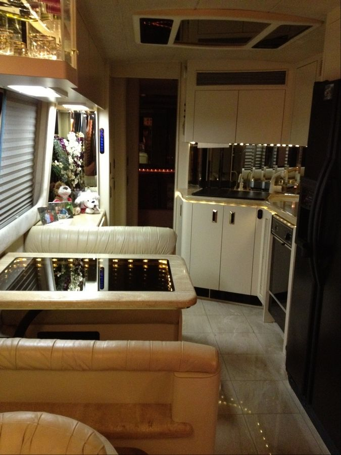 With a floor that's fancier than many suburban kitchen floors, this luxury RV truly is a home away from home.