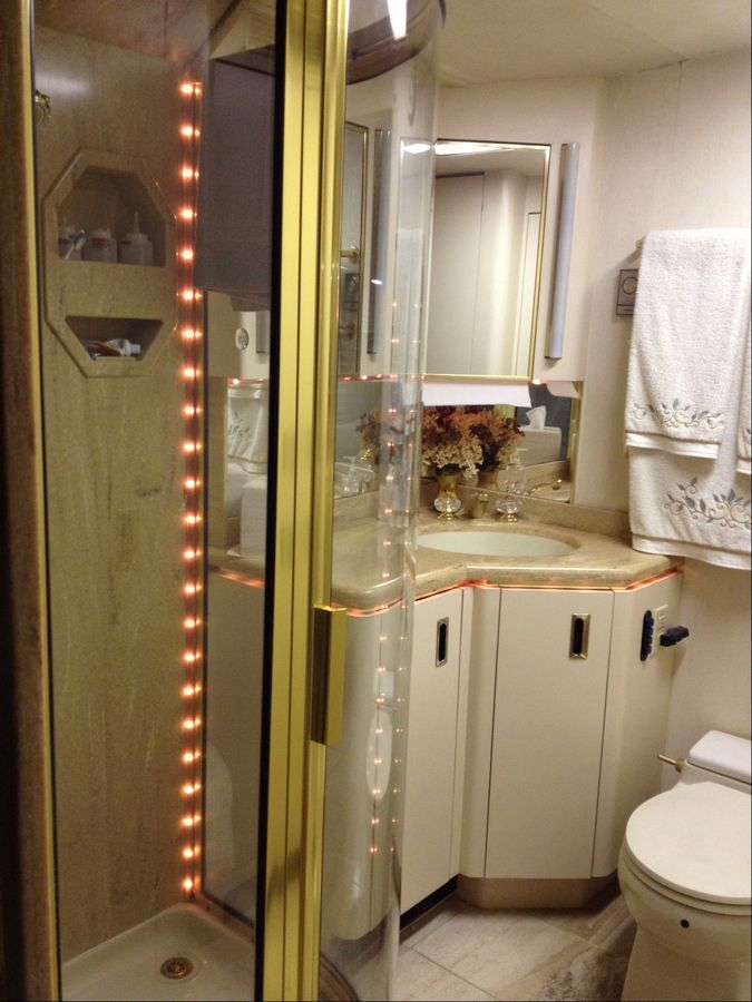 The bathroom in this luxury RV has large water storage tanks that can last days without having to be filled or emptied.