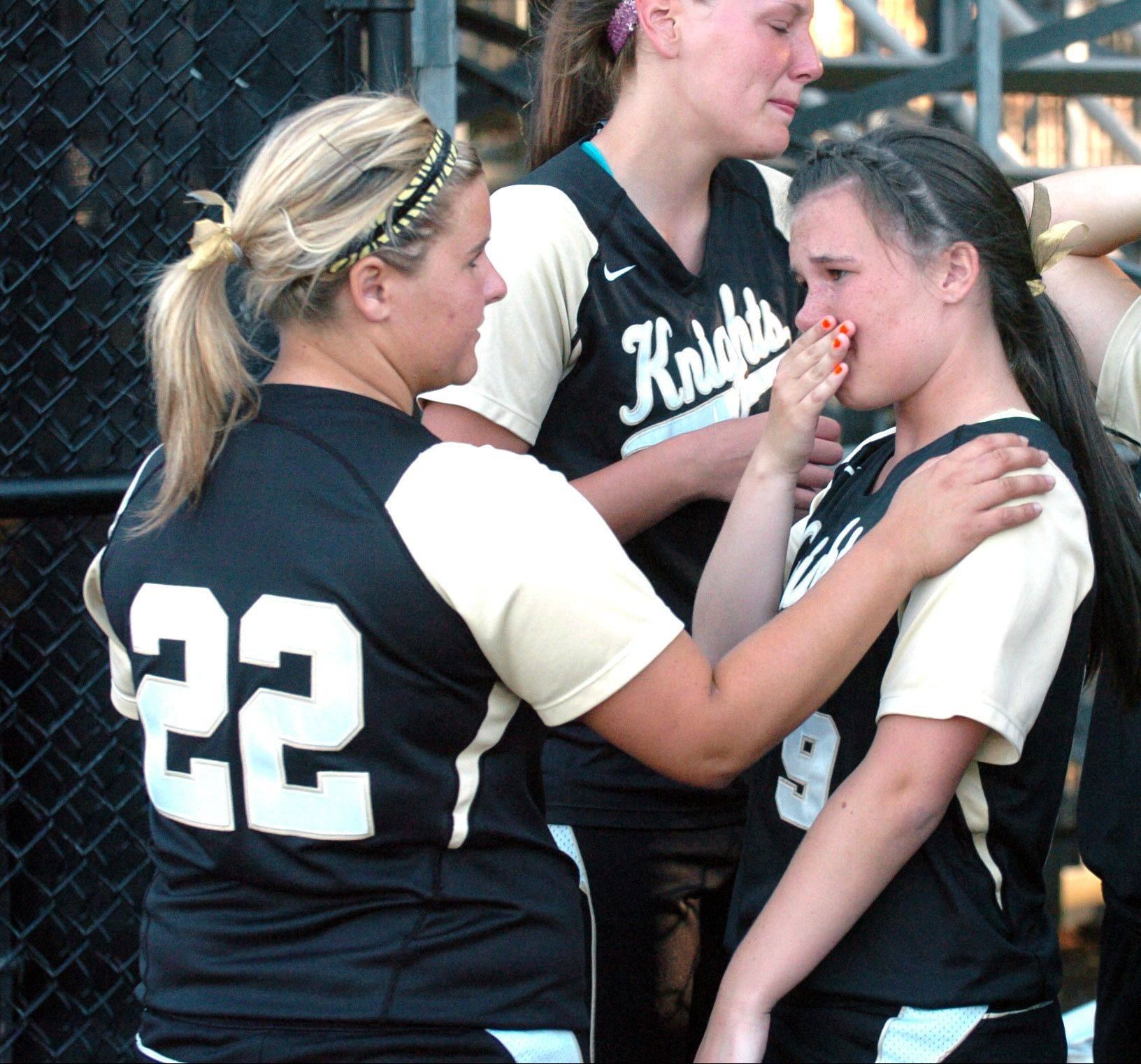 Kelsey Borders, left, and Jessica Davis shed a tear after Grayslake North's 2-1 loss to Marengo in DeKalb on Tuesday.