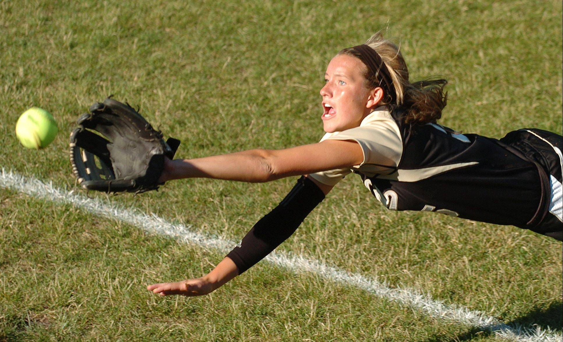 Jordyn Bowen of Grayslake North stretches out in pursuit of a foul ball against Marengo.
